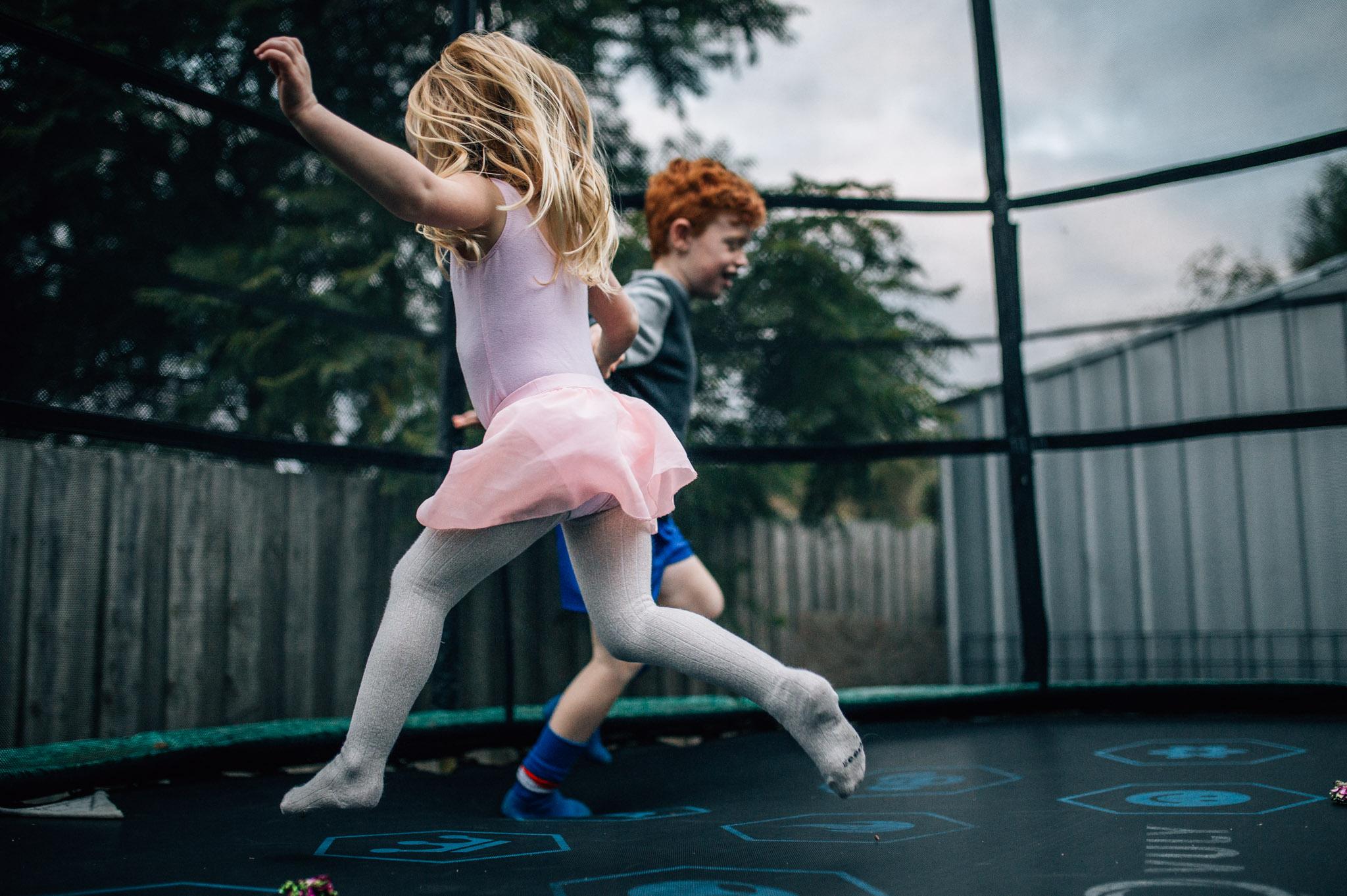 Children running on trampoline.