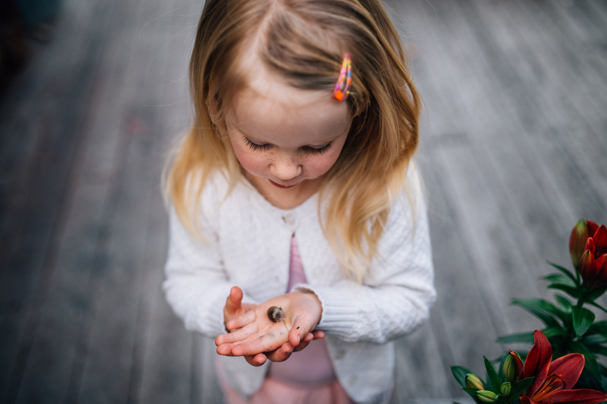 Little girl with tiny snail.