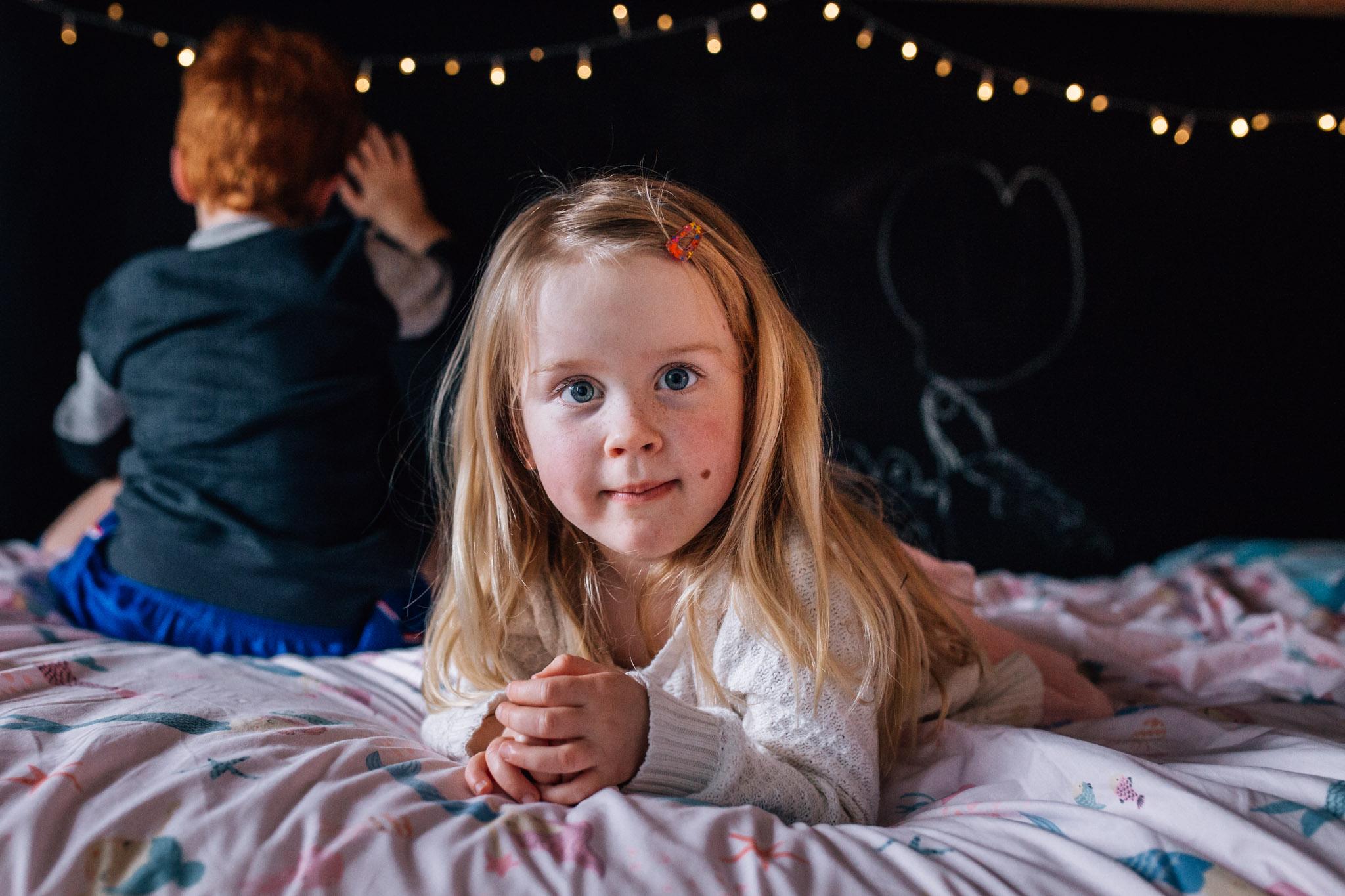 Little girl on her bed.