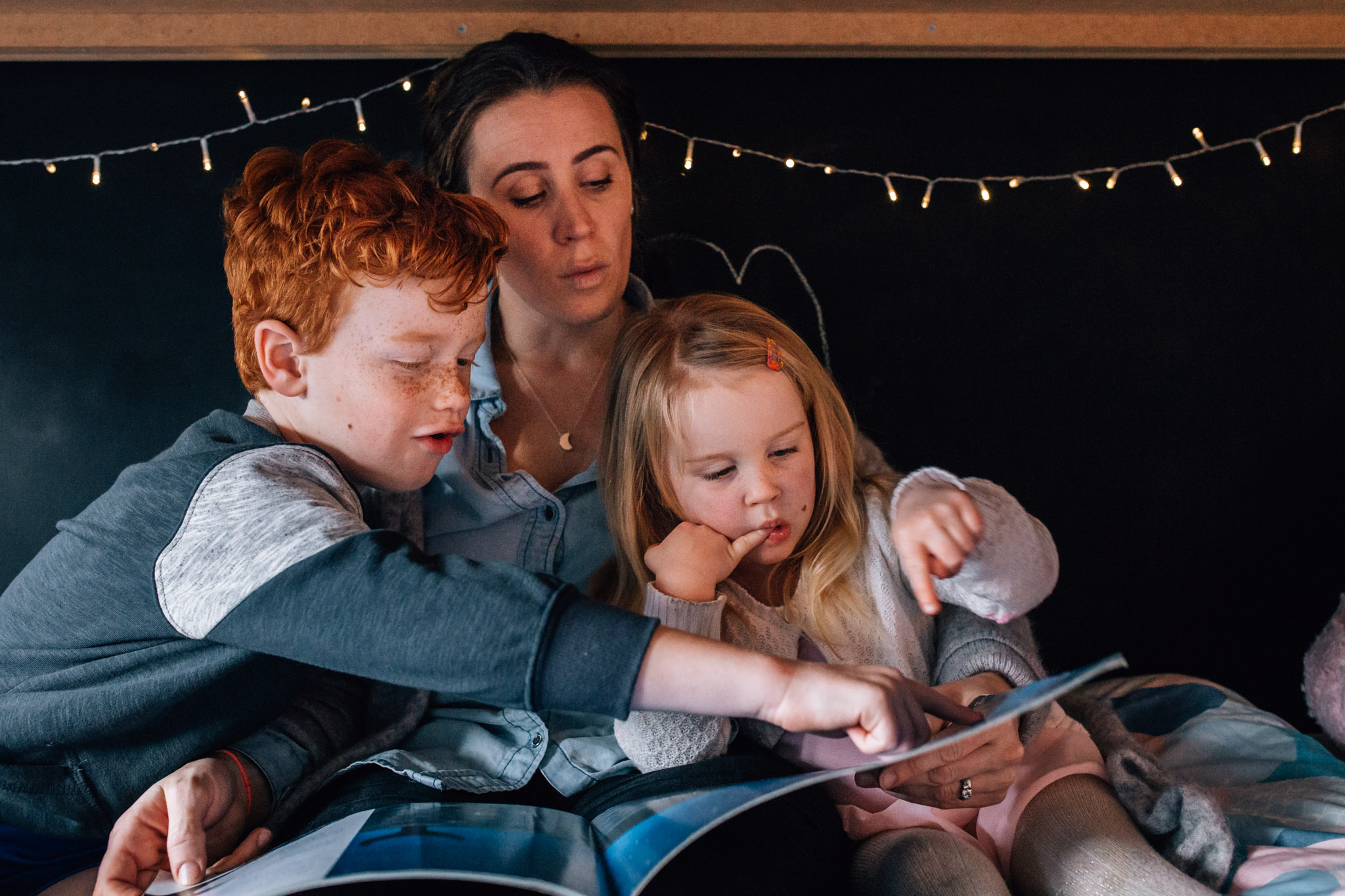 Mother and children reading.
