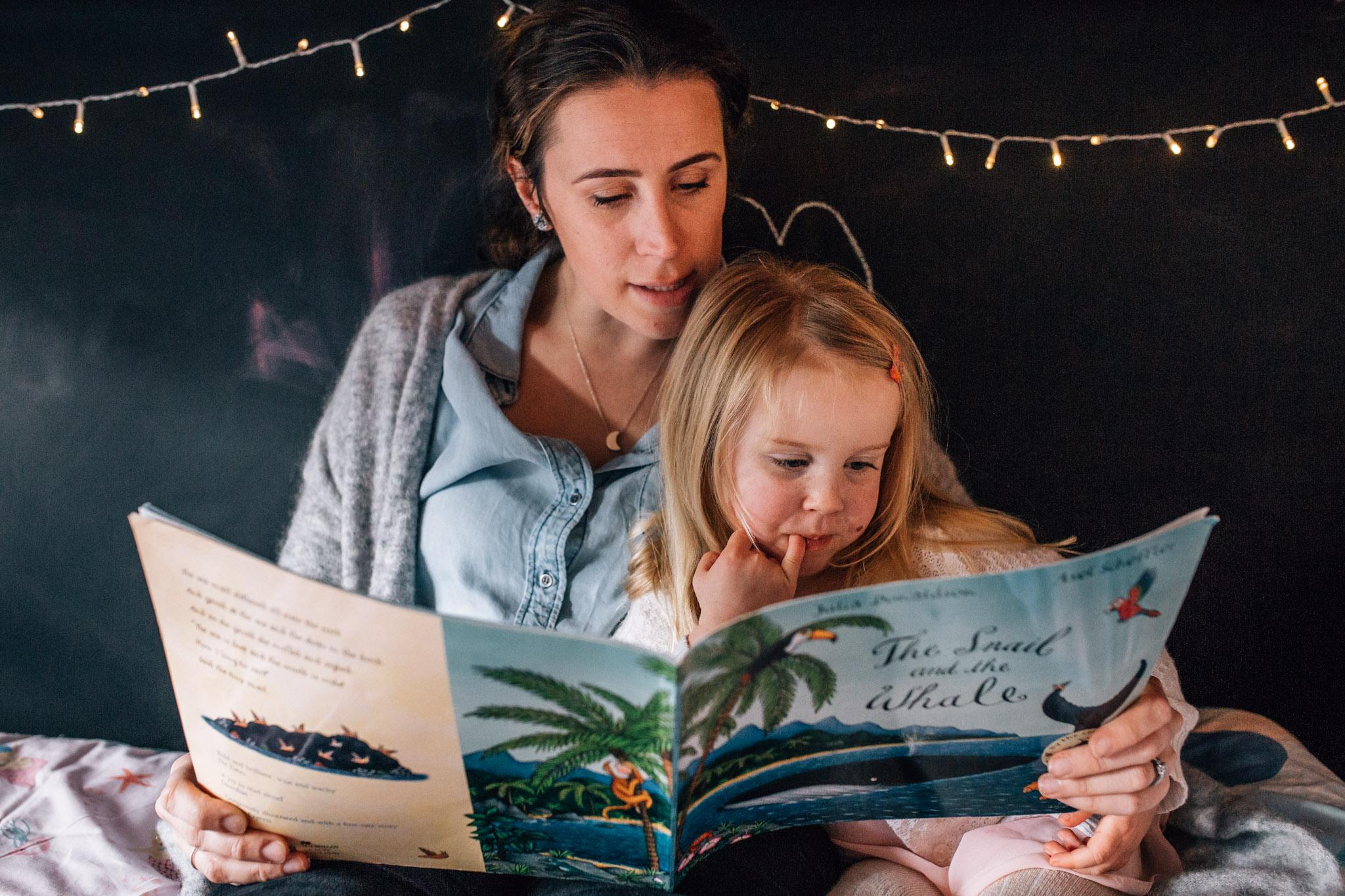Mum and daughter reading.