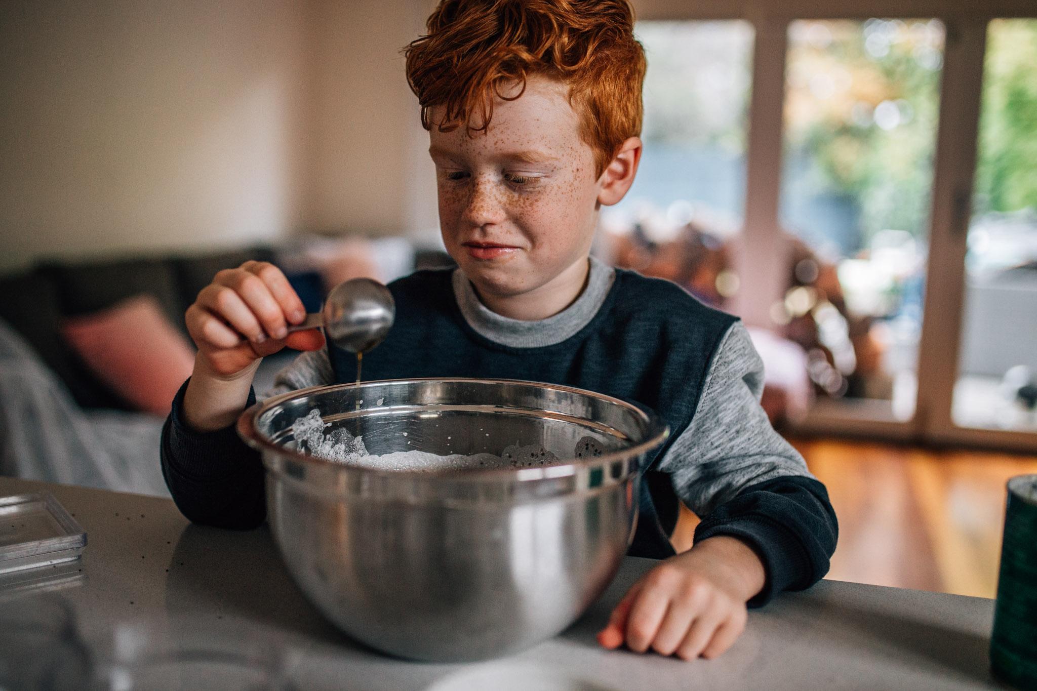 Boy tasting cooking.
