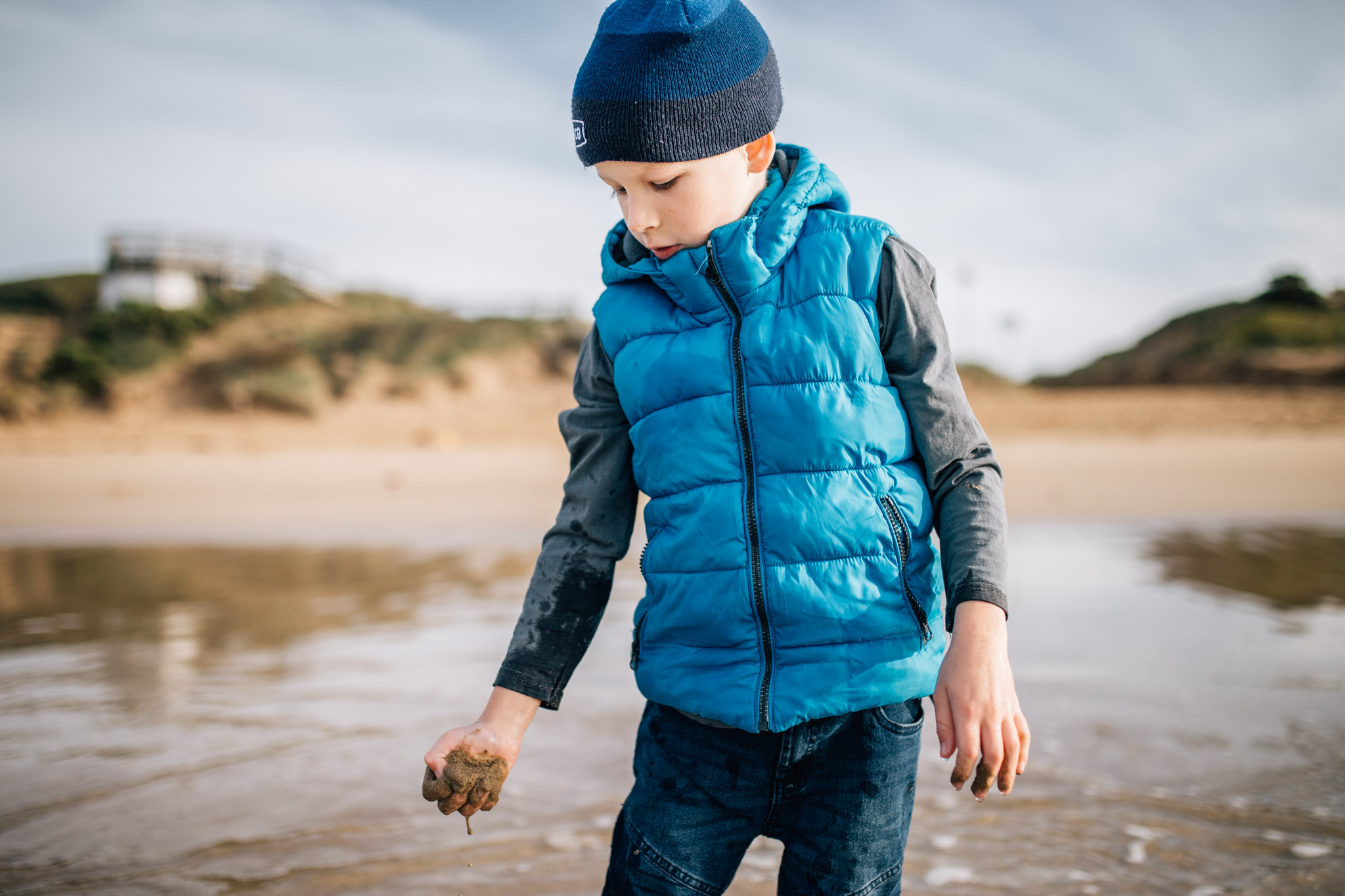 boy playing with sand at beach (1 of 1).jpg