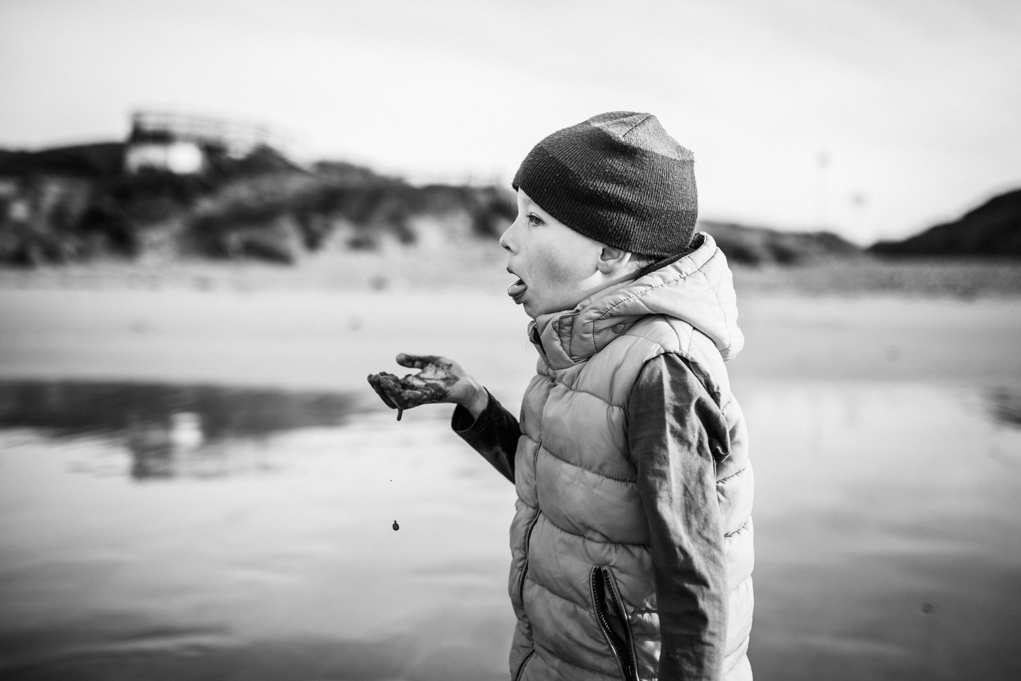 boy pretending to eat sand at beach (1 of 1).jpg