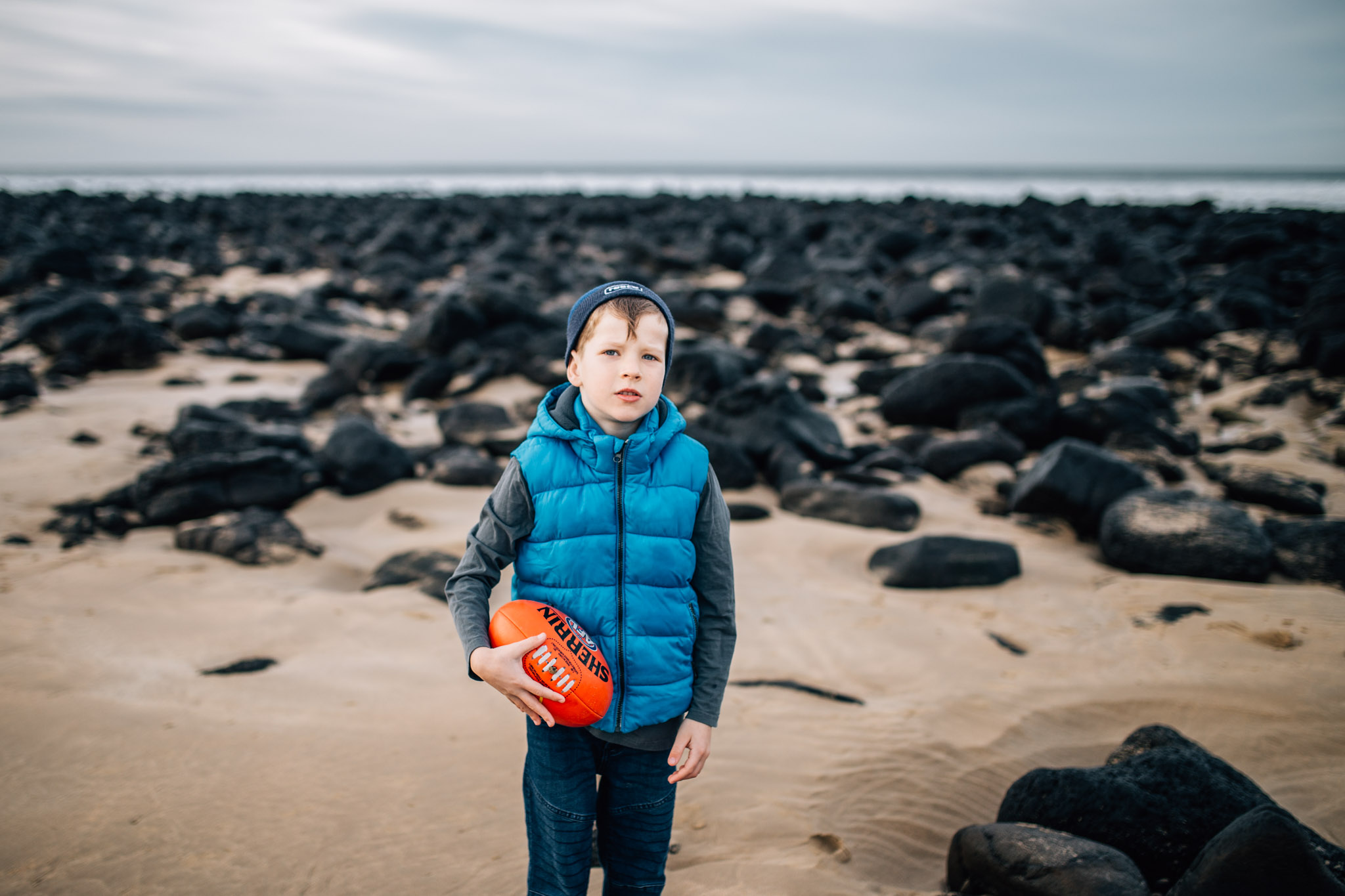 boy with football on beach (1 of 1).jpg