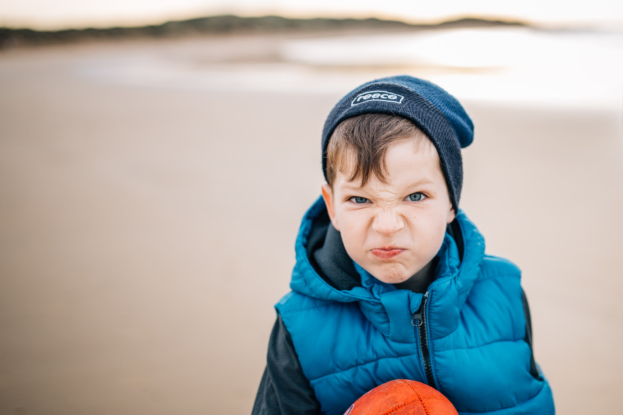 boy with scrunchy grumpy face (1 of 1).jpg