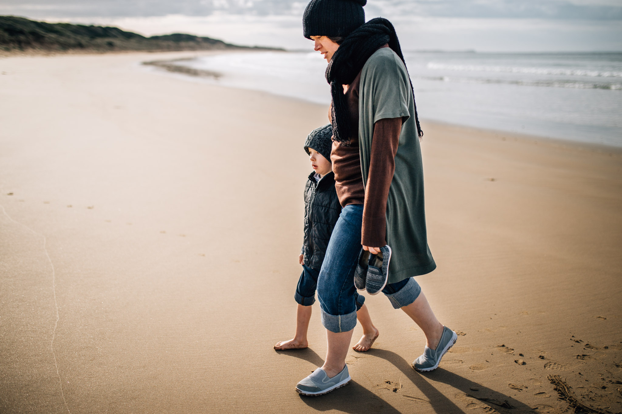 mother and son walking on sand (1 of 1).jpg