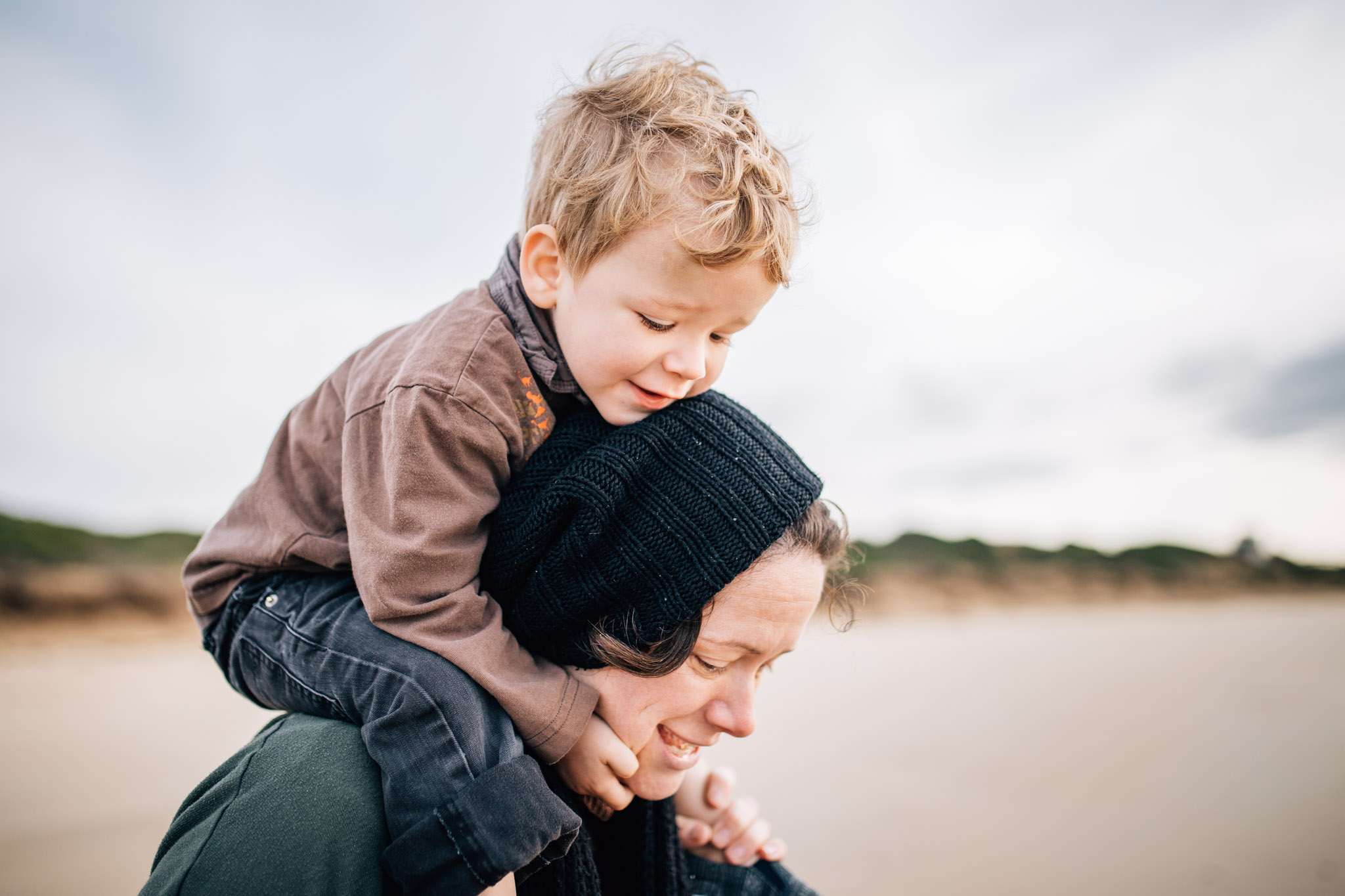 toddler boy on mothers shoulders (1 of 1).jpg