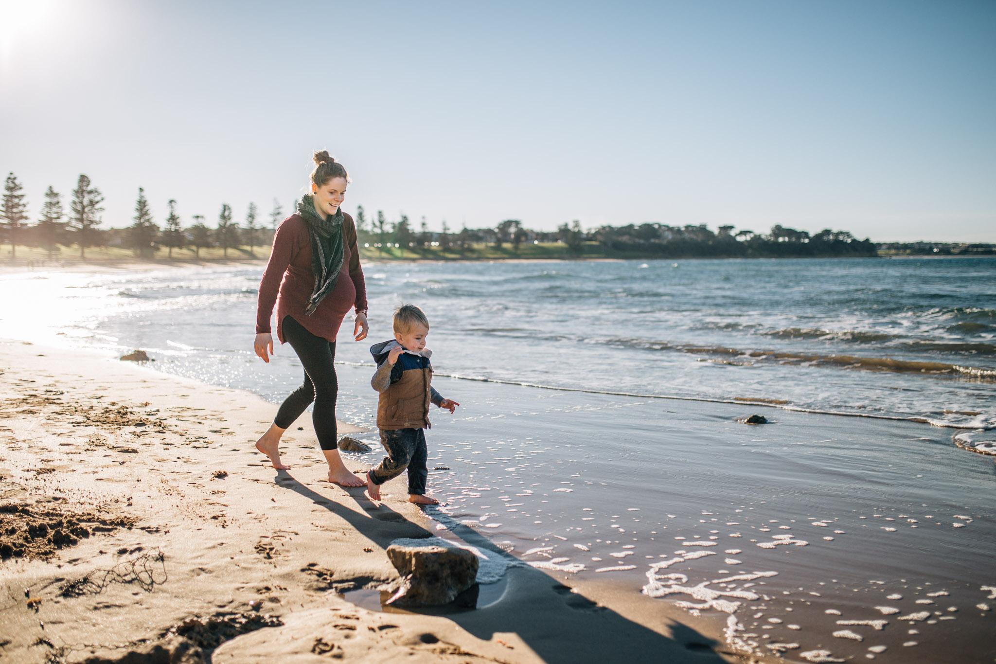 mother chasing toddler boy on beach (1 of 1).jpg