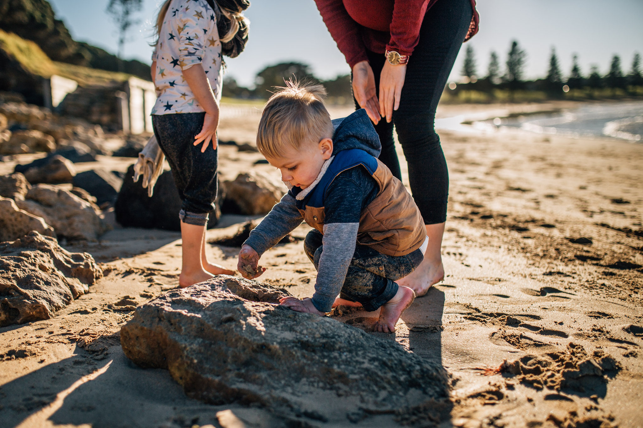 toddler boy at rocks with mother and sister (1 of 1).jpg