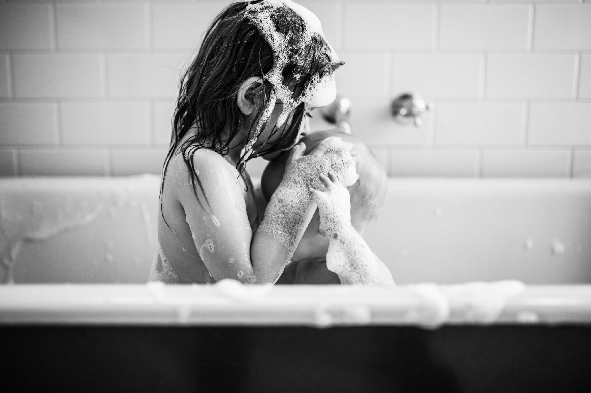 toddler and baby in the bath II BW (1 of 1).jpg