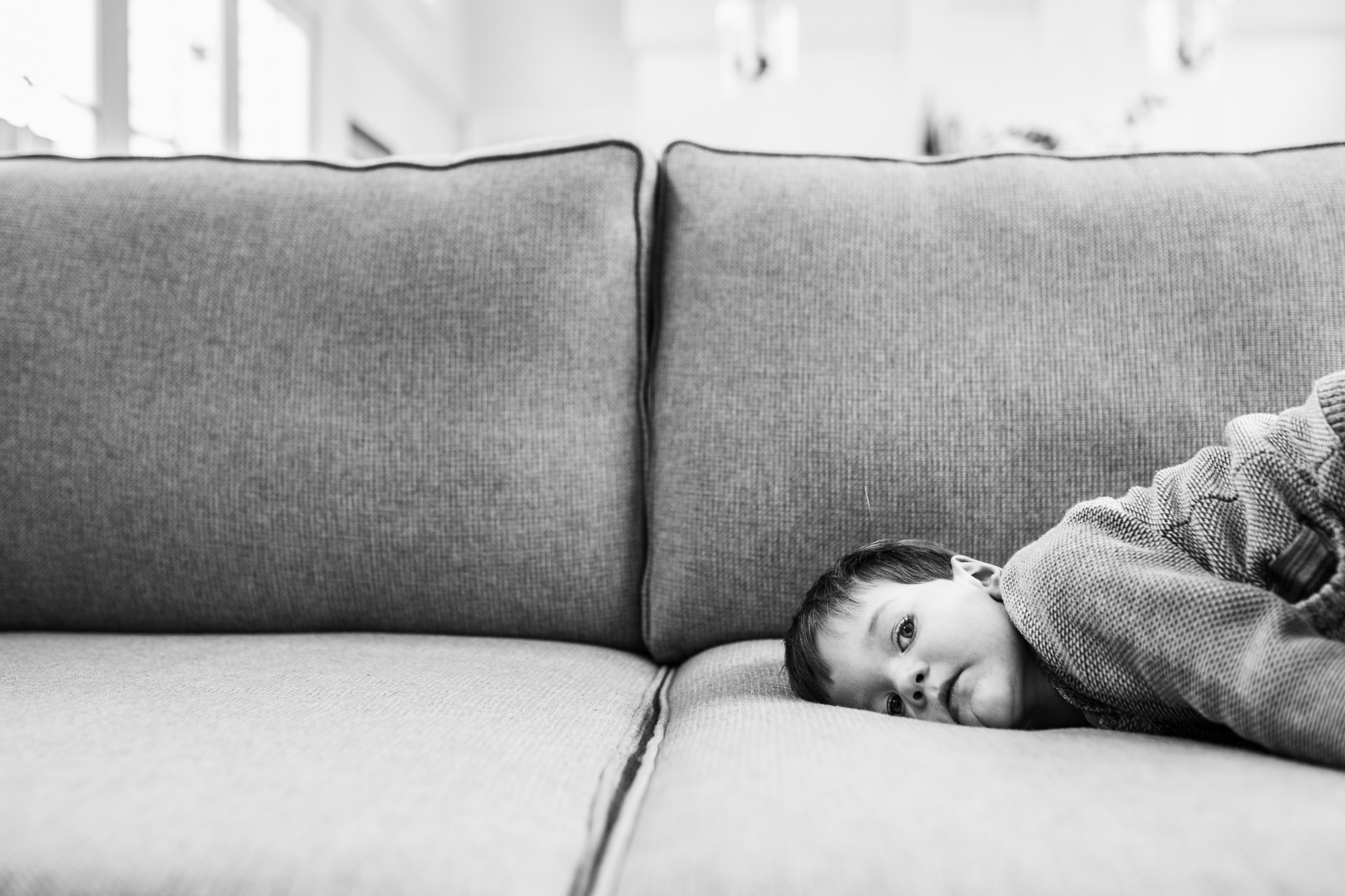 bored boy on sofa (1 of 1).jpg