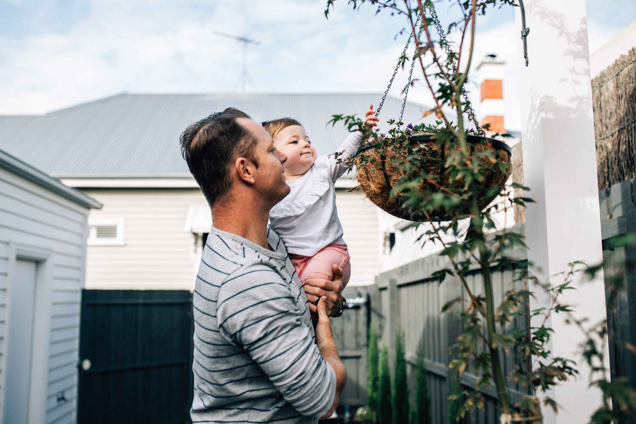 little girl in garden with father (1 of 1).jpg