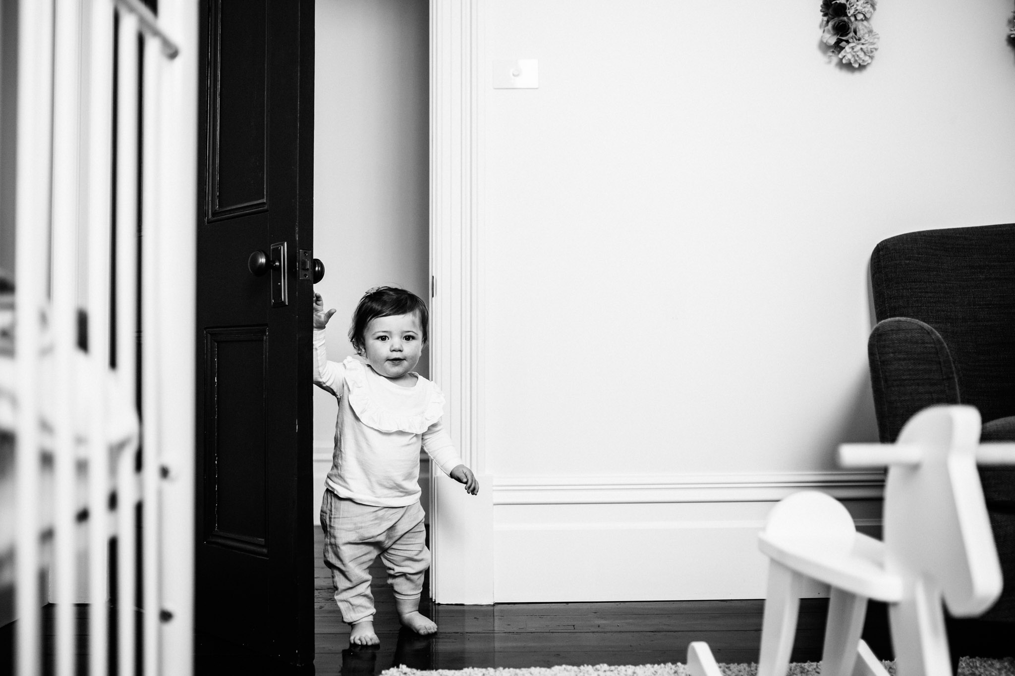 little girl in bedroom door (1 of 1).jpg