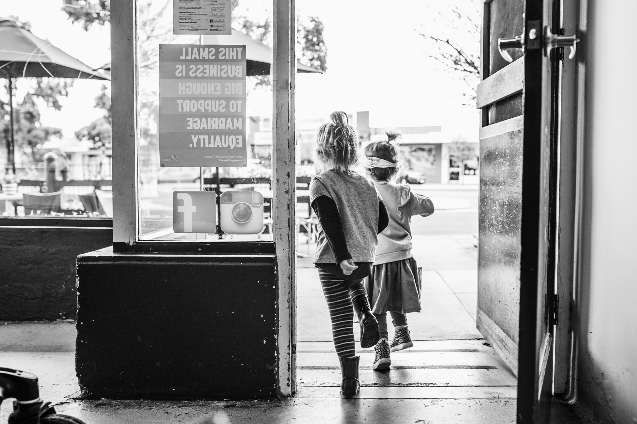 girls running out of cafe BW (1 of 1).jpg