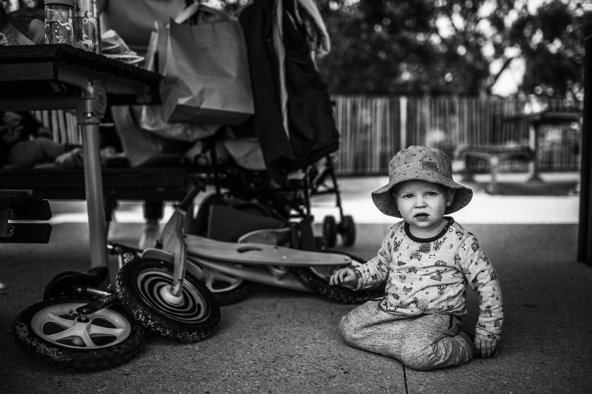 little boy crowching beside bikes (1 of 1).jpg