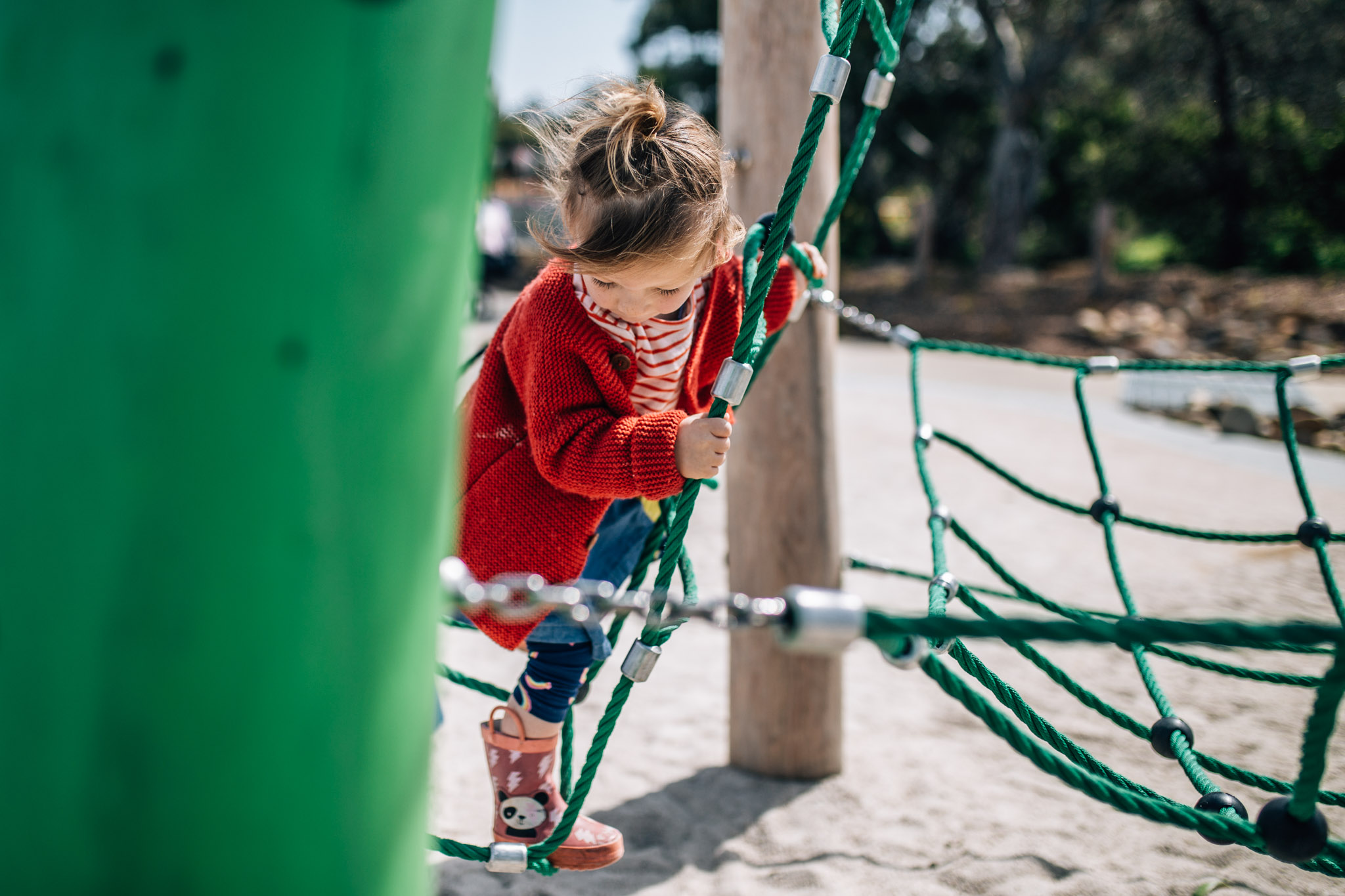 little girl in red cardigan climbing play equipment IV (1 of 1).jpg