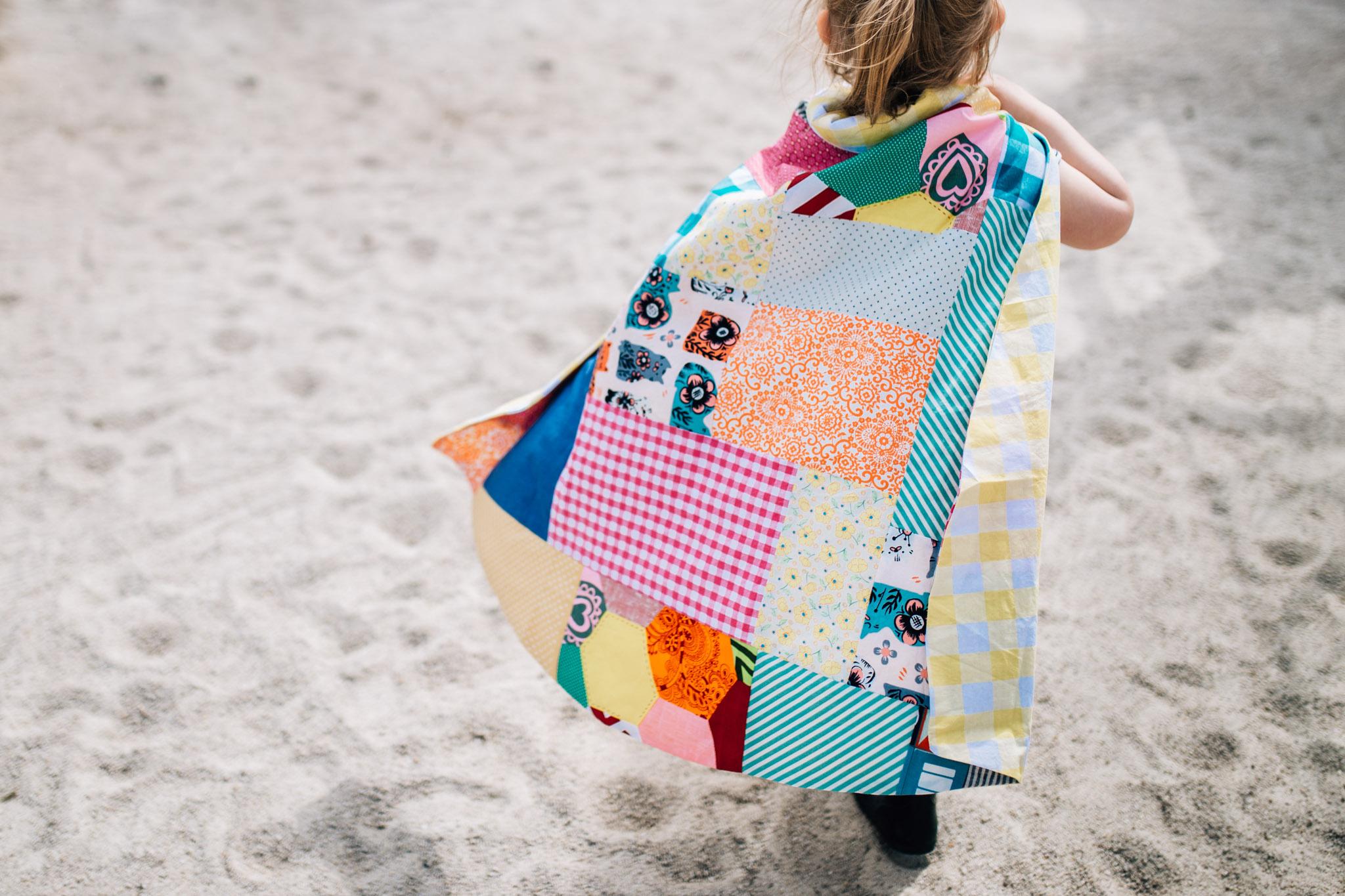little girl wearing patchwork cape (1 of 1).jpg
