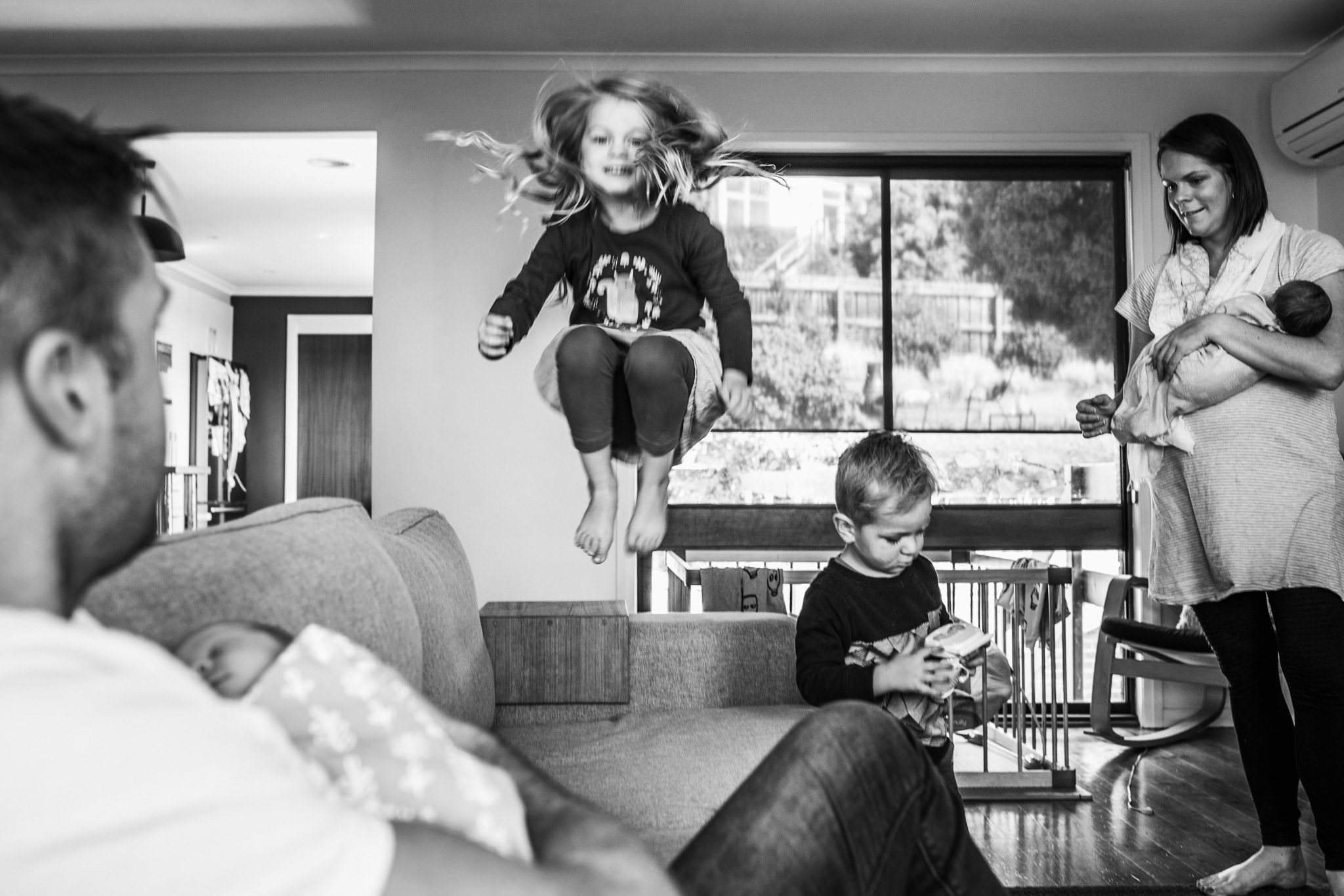 little girl jumping on couch motion blur (1 of 1).jpg