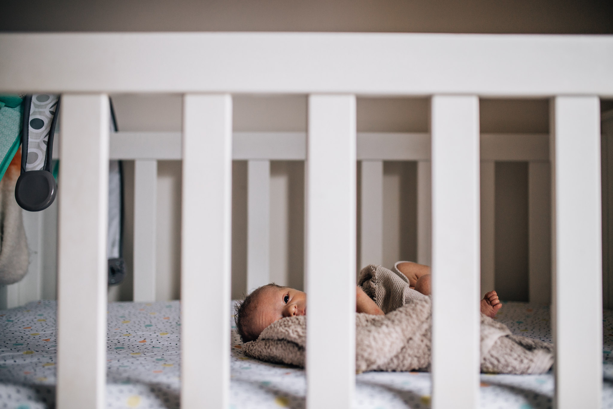 naked baby lying in cot waiting to be dressed (1 of 1).jpg