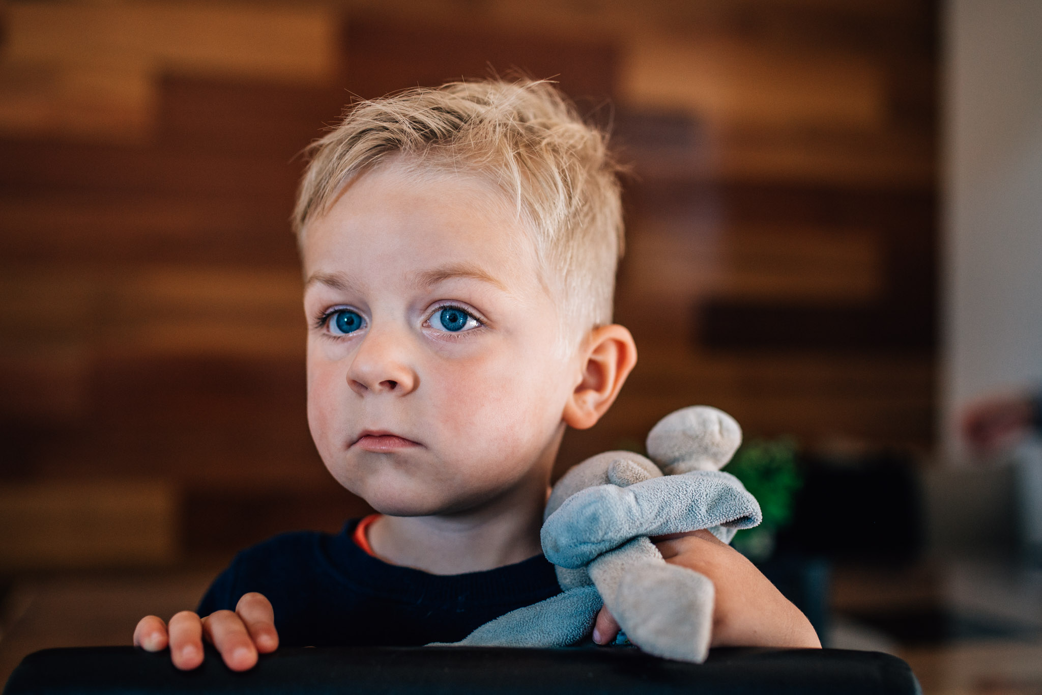 little boy watching tv with lovey (1 of 1).jpg