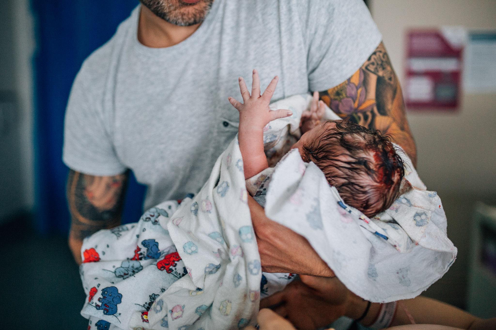 dad handing baby to mother (1 of 1).jpg