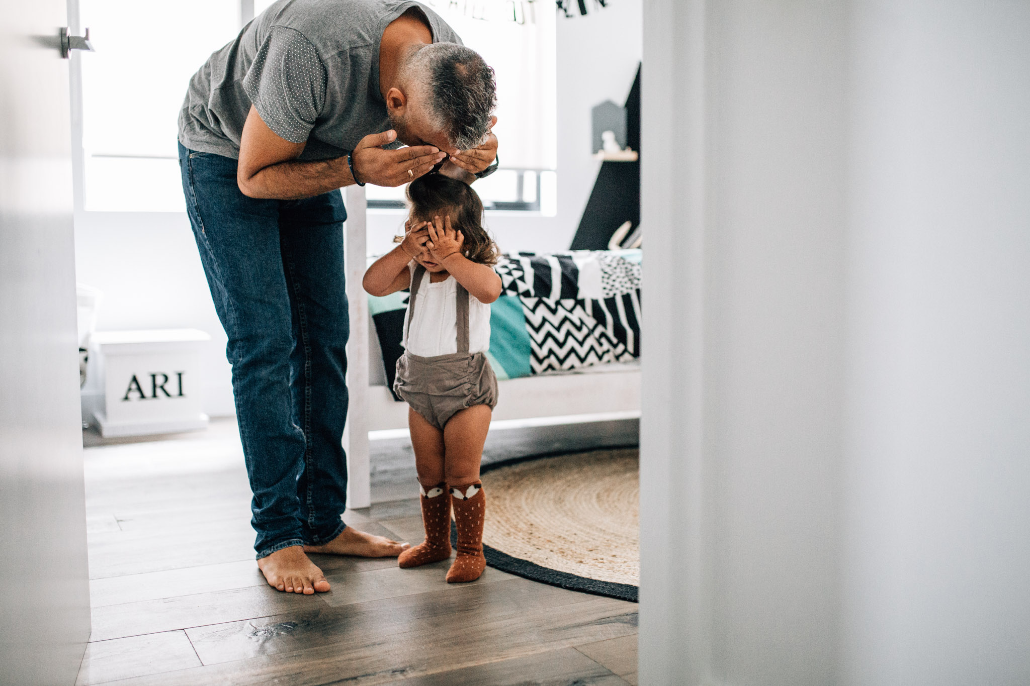 daddy and daughter playing hide and seek (1 of 1).jpg