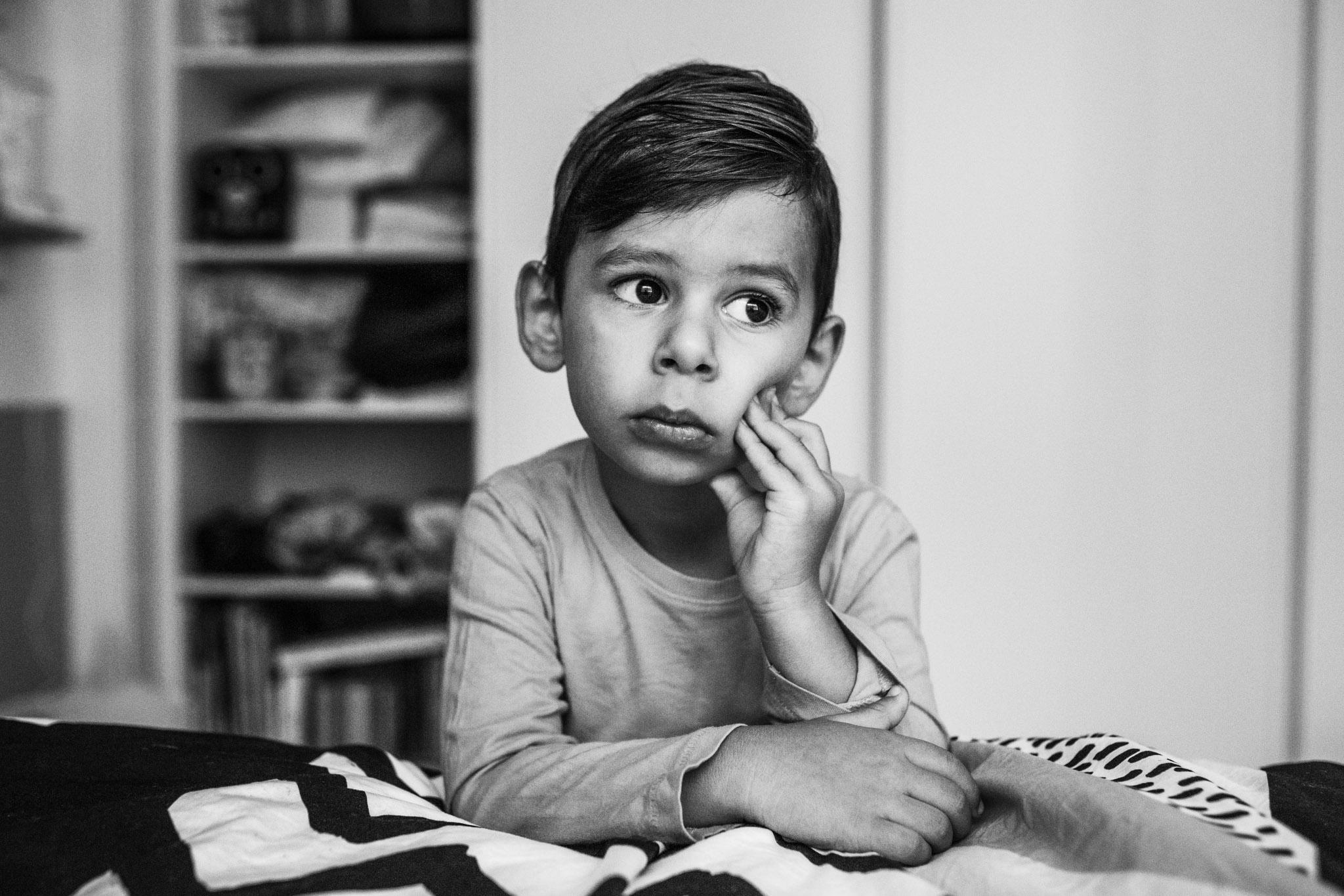 litle boy in his bedroom BW (1 of 1).jpg