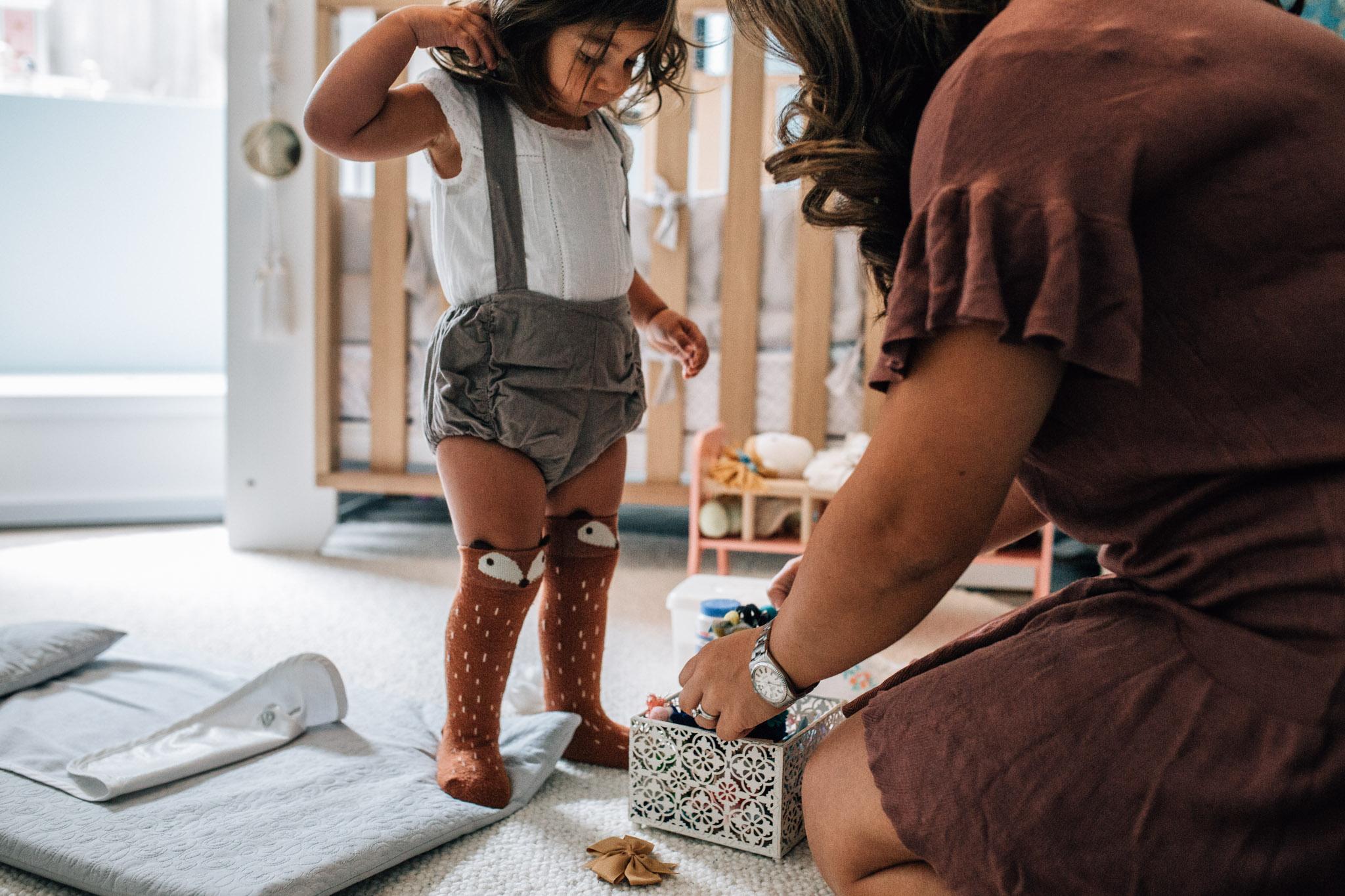 little girl choosing which bow for her hair (1 of 1).jpg