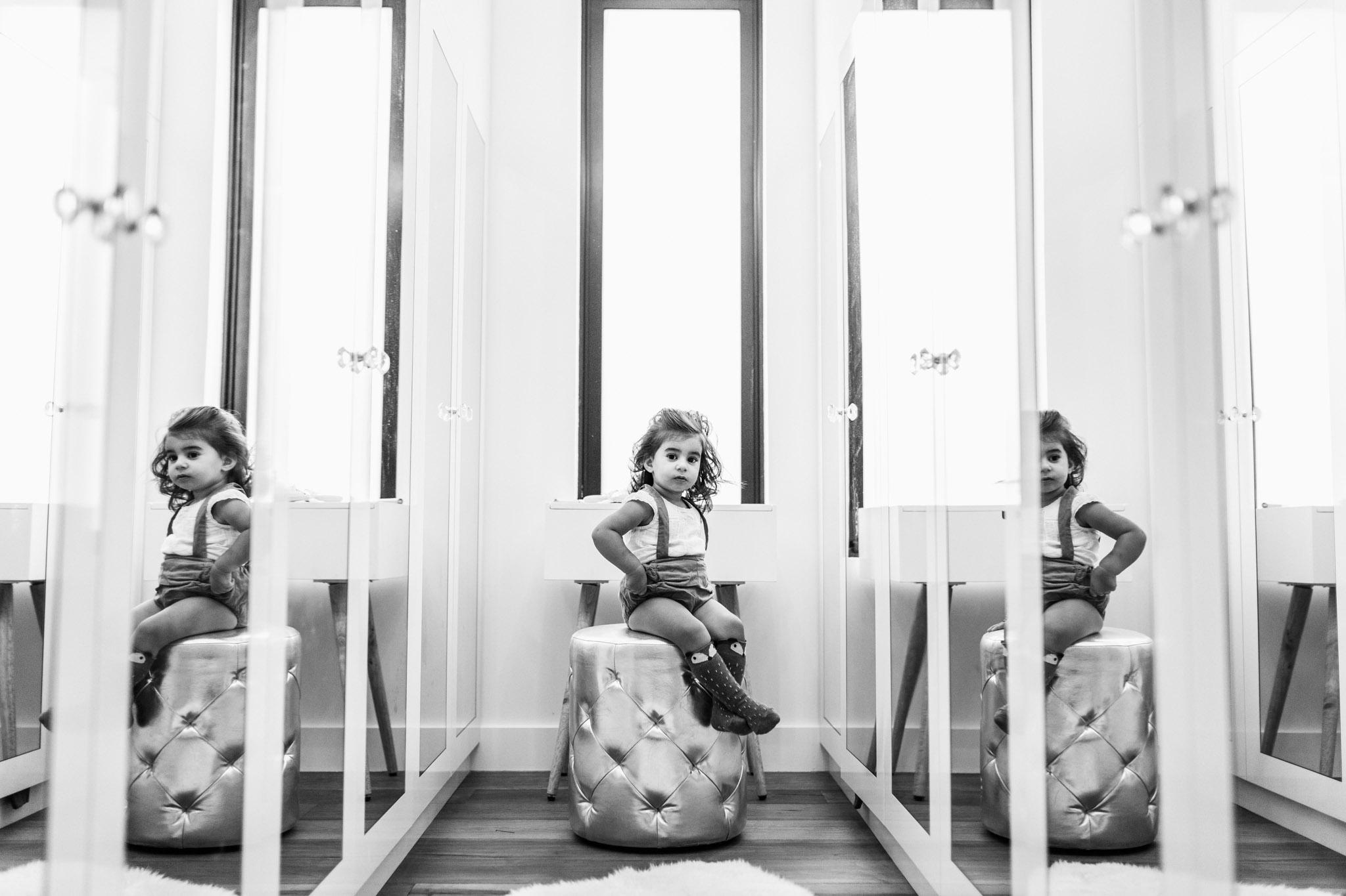 little girl sitting in mothers mirrored closet II (1 of 1).jpg