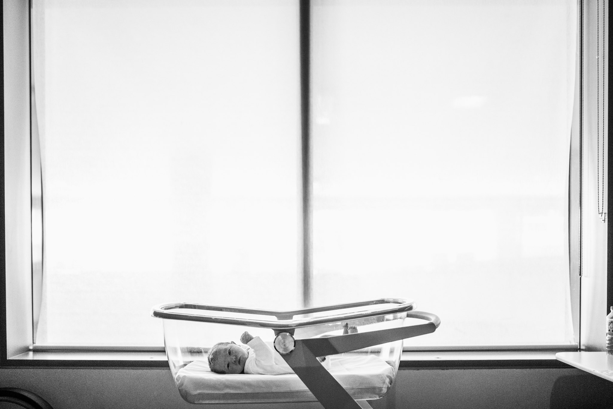 baby in bassinet in front of a hospital window (1 of 1).jpg