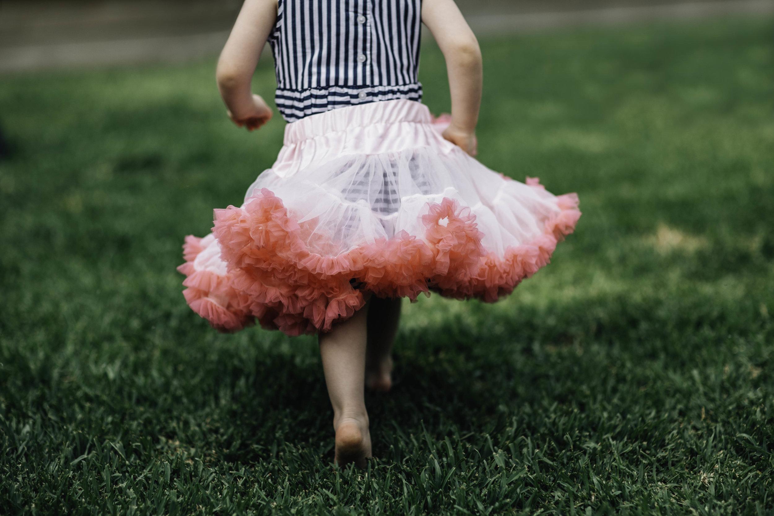 little-girl-running-in-fluffy-tutu-on-green-grass.jpg
