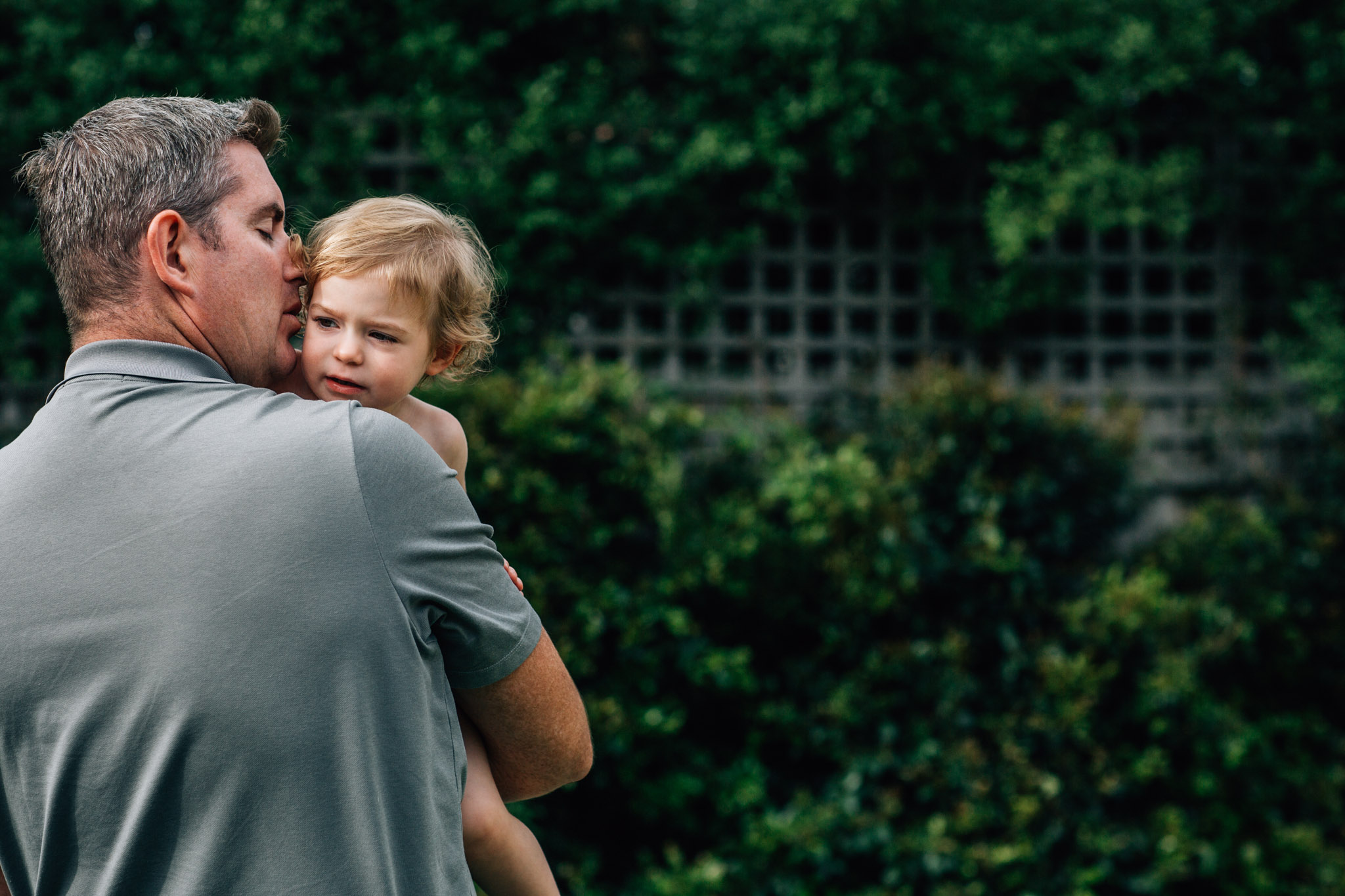 daddy-whispering-something-in-his-toddlers-ear (1 of 1).jpg