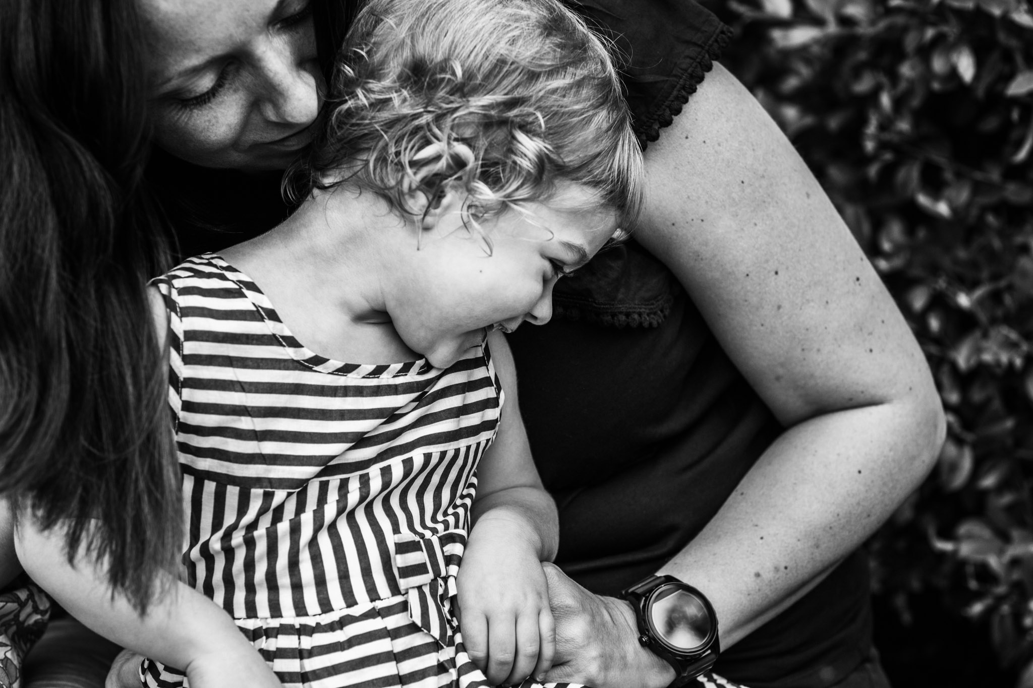 mother-snuggling-into-laughing-toddler (1 of 1).jpg