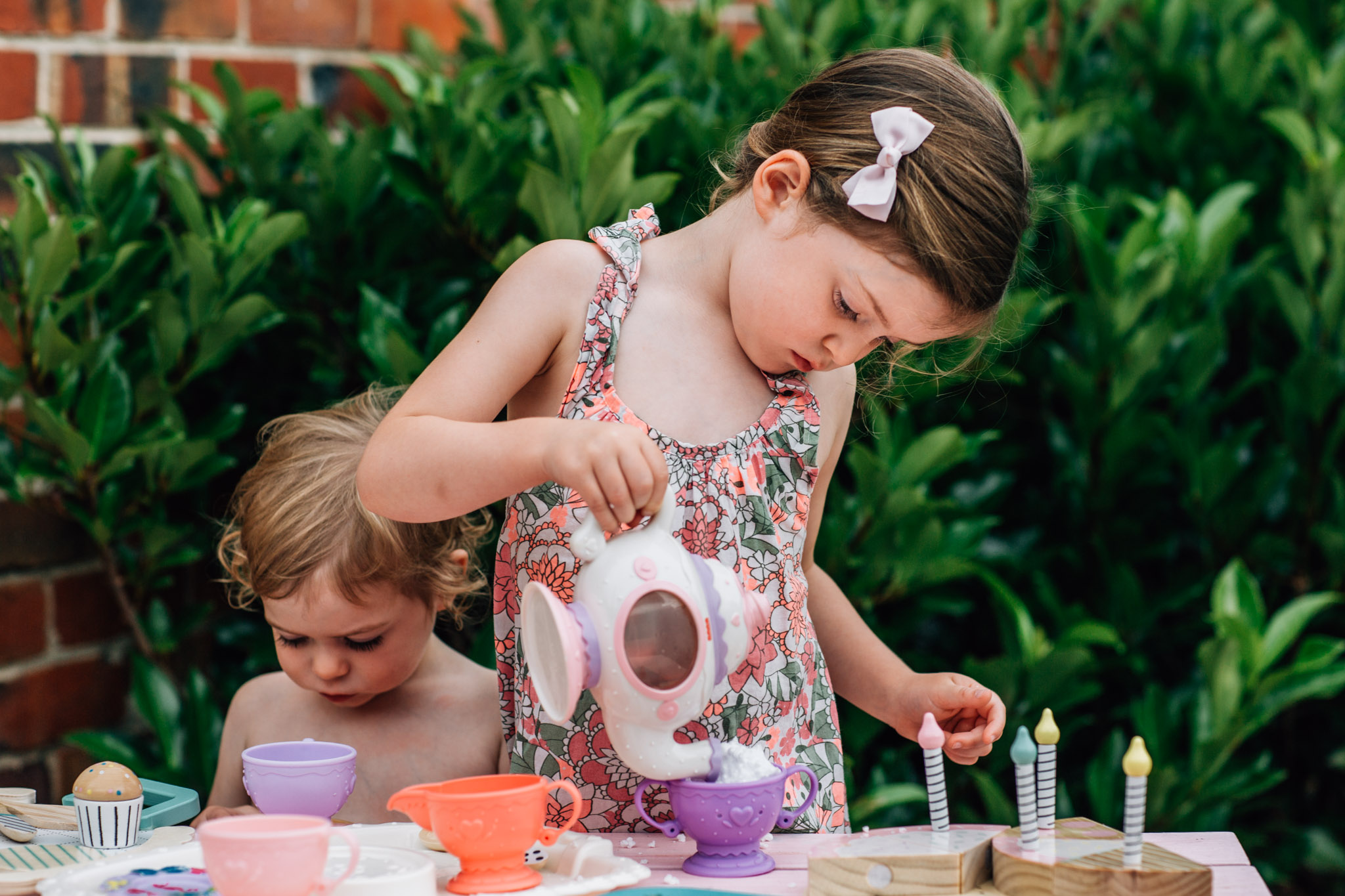 little-girl-at-tea-party-pouring-tea-from-teapot (1 of 1).jpg