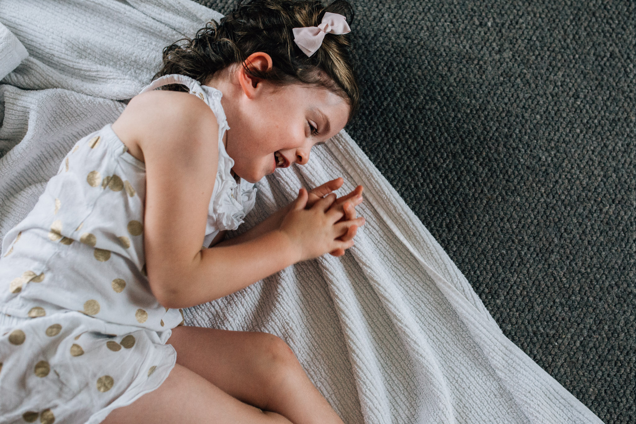 little-girl-laughing-on-living-room-floor (1 of 1).jpg
