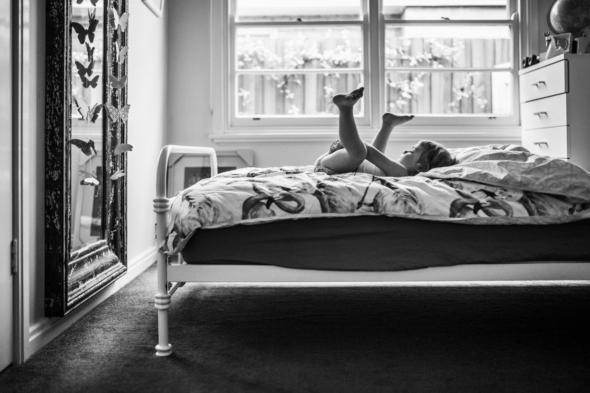 little-girl-playing-on-bed-with-flamingo-doona (1 of 1).jpg