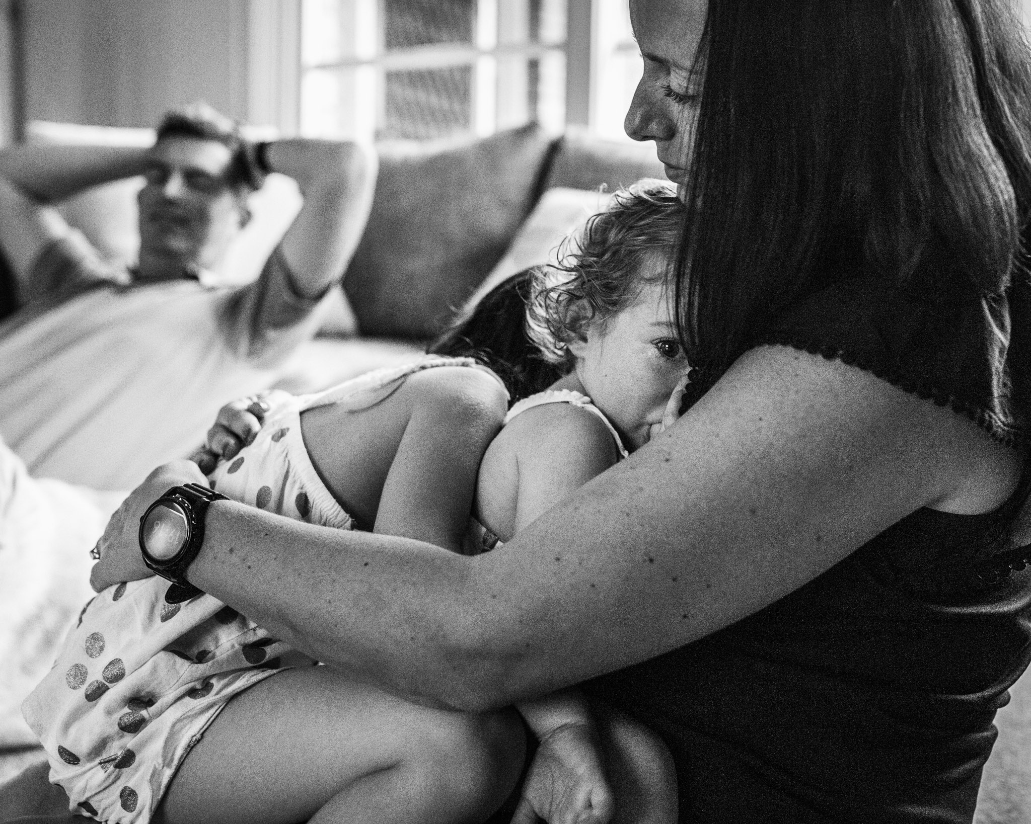 mother-snuggling-two-tired-daughters (1 of 1).jpg