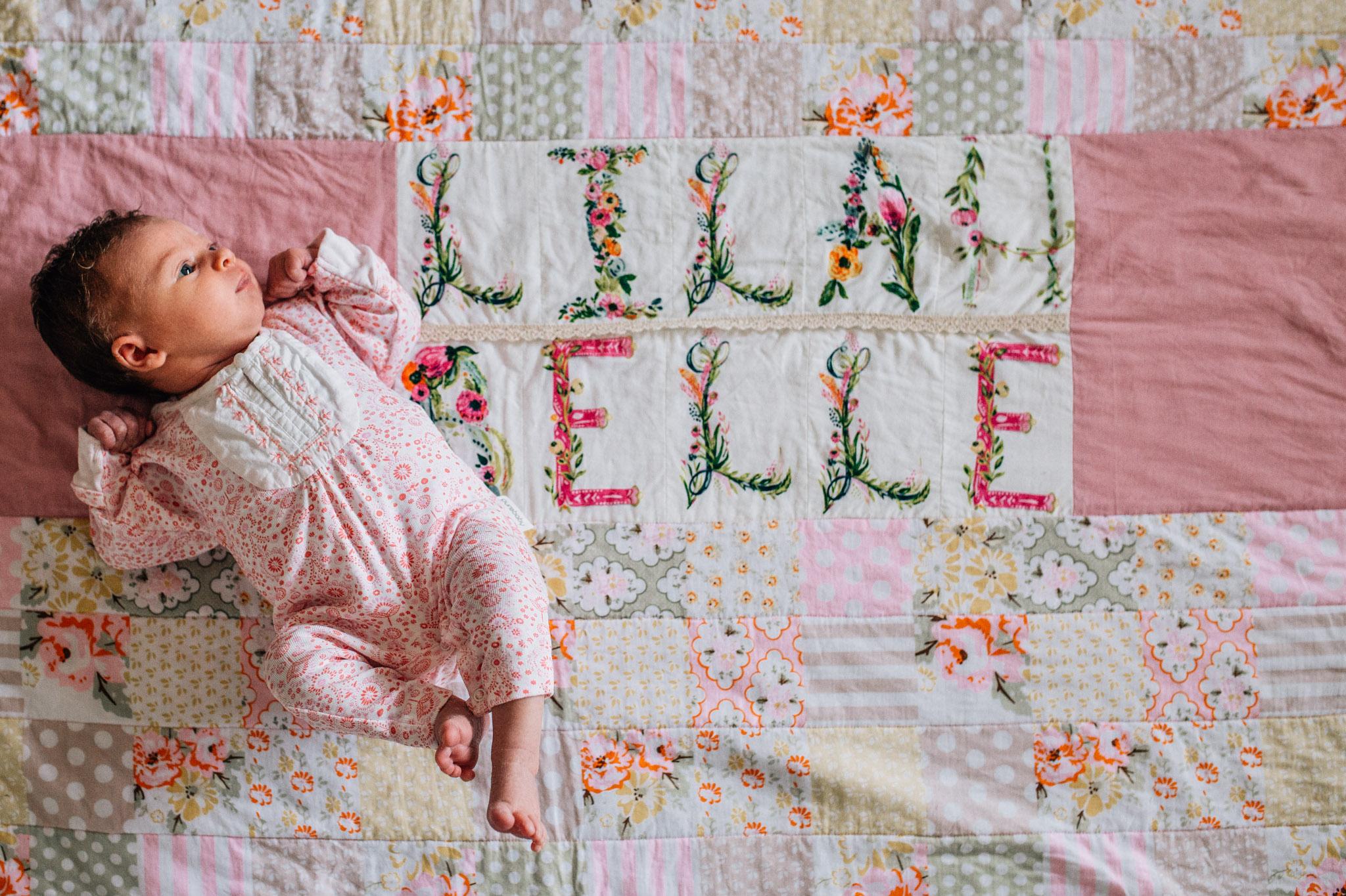 baby-lying-on-handmade-blanket-with-her-name-on-it-II (1 of 1).jpg