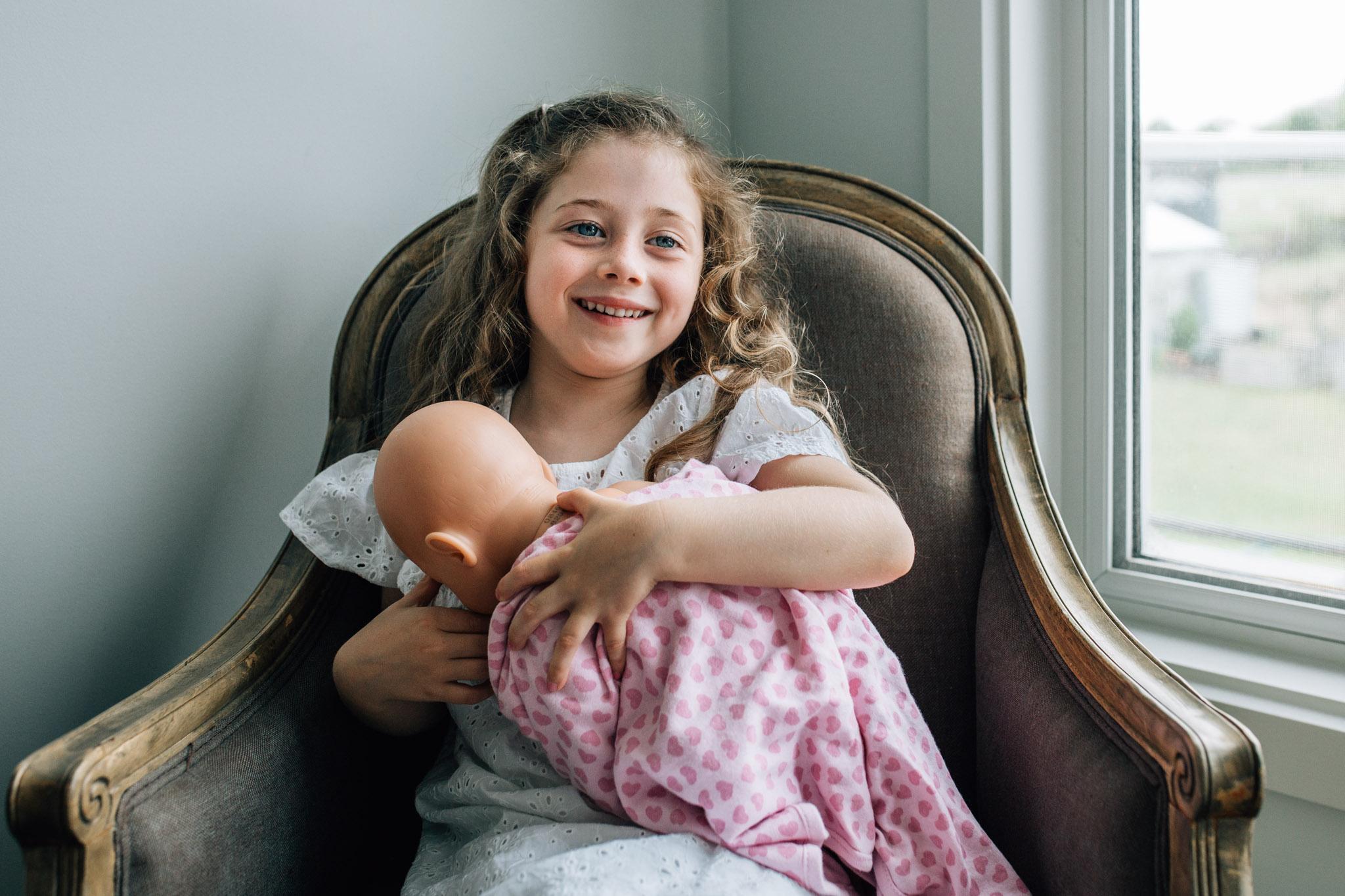 little-girl-pretending-to-breastfeed-baby-doll (1 of 1).jpg