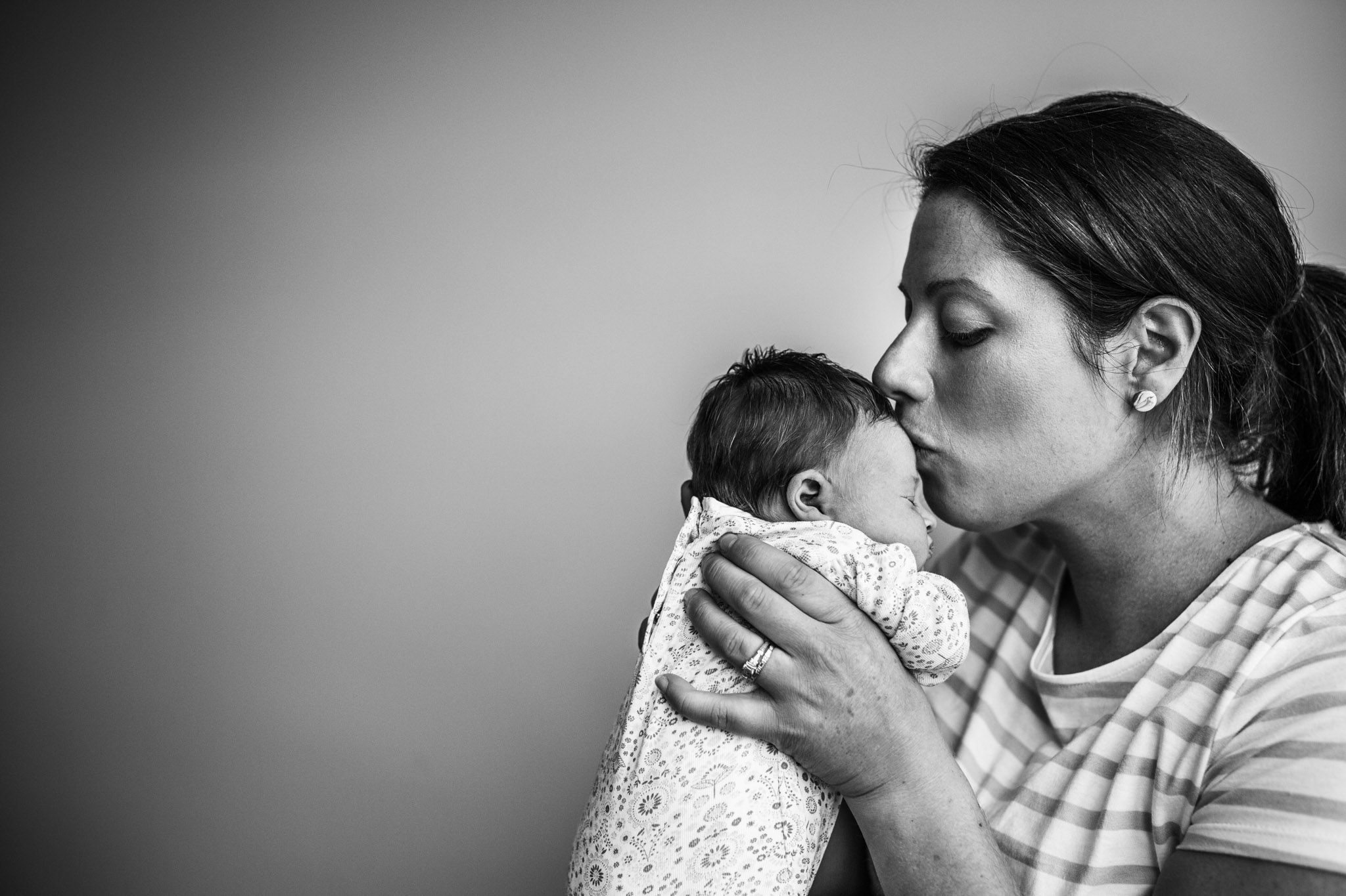 mother-kissing-newborn-daughter-on-the-head (1 of 1).jpg