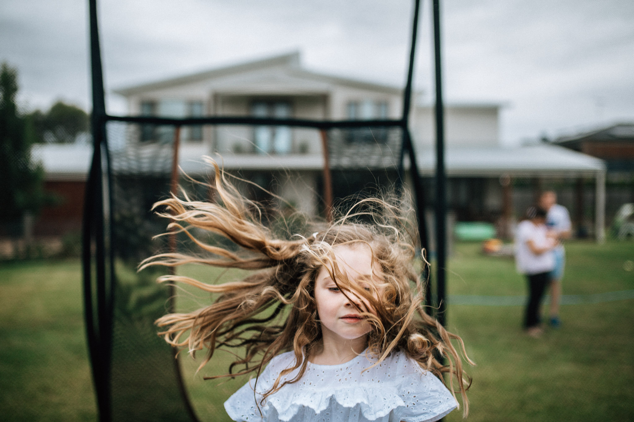girl-on-trampoline-with-blonde-wavy-hair (1 of 1).jpg