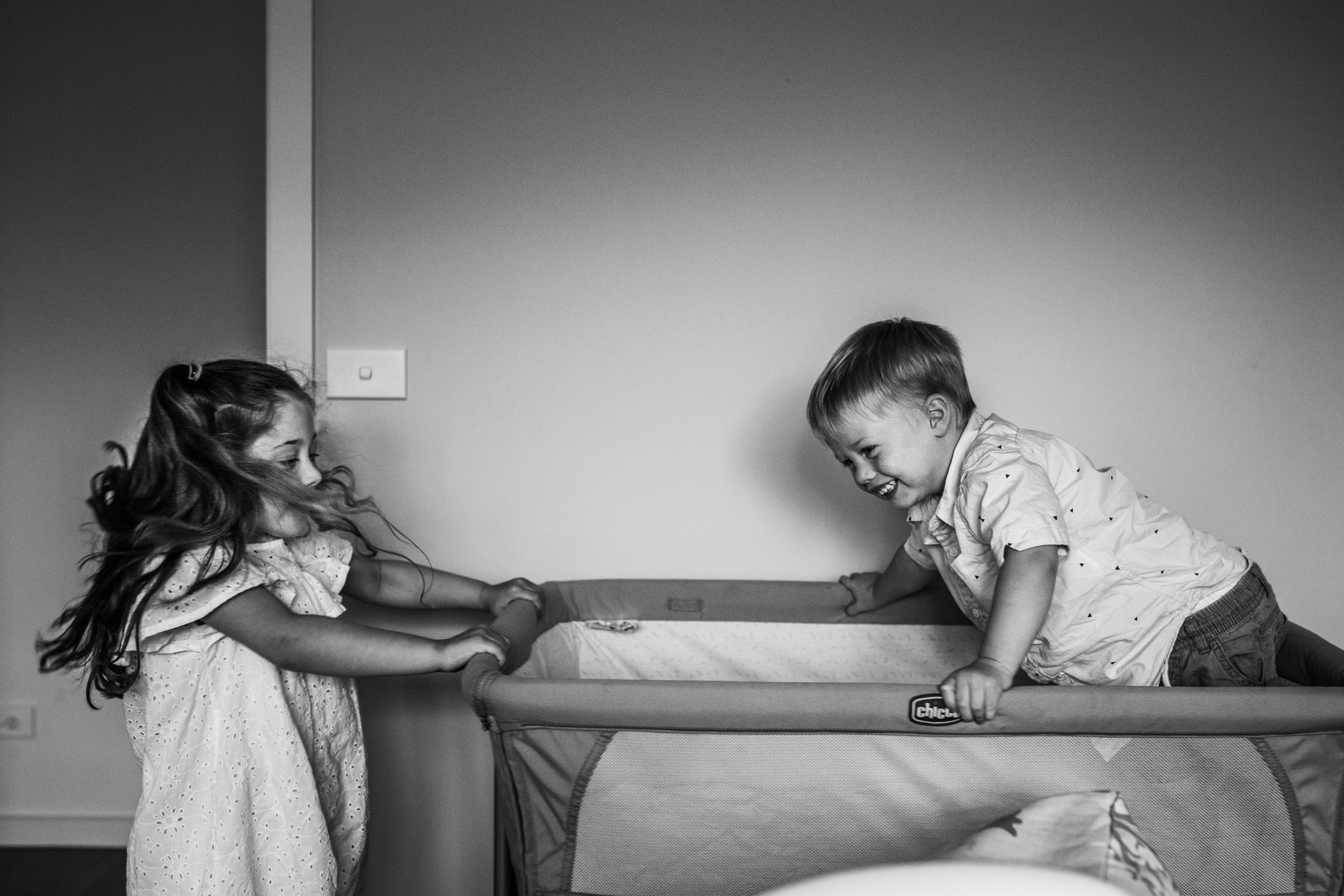 children-playing-in-baby-bassinet (1 of 1).jpg