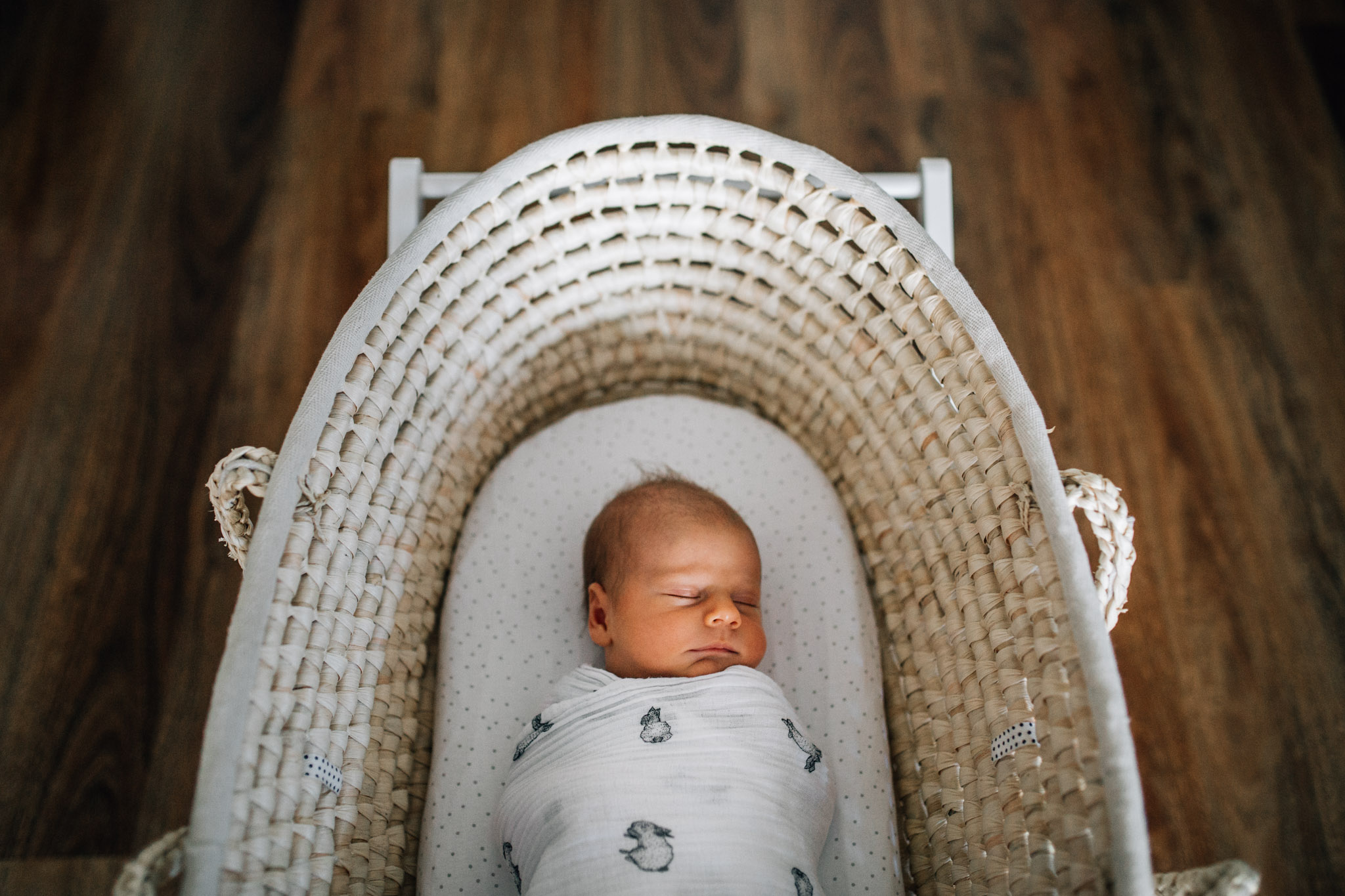 swaddled-baby-sleeping-soundly-in-wicker-bassinet (1 of 1).jpg