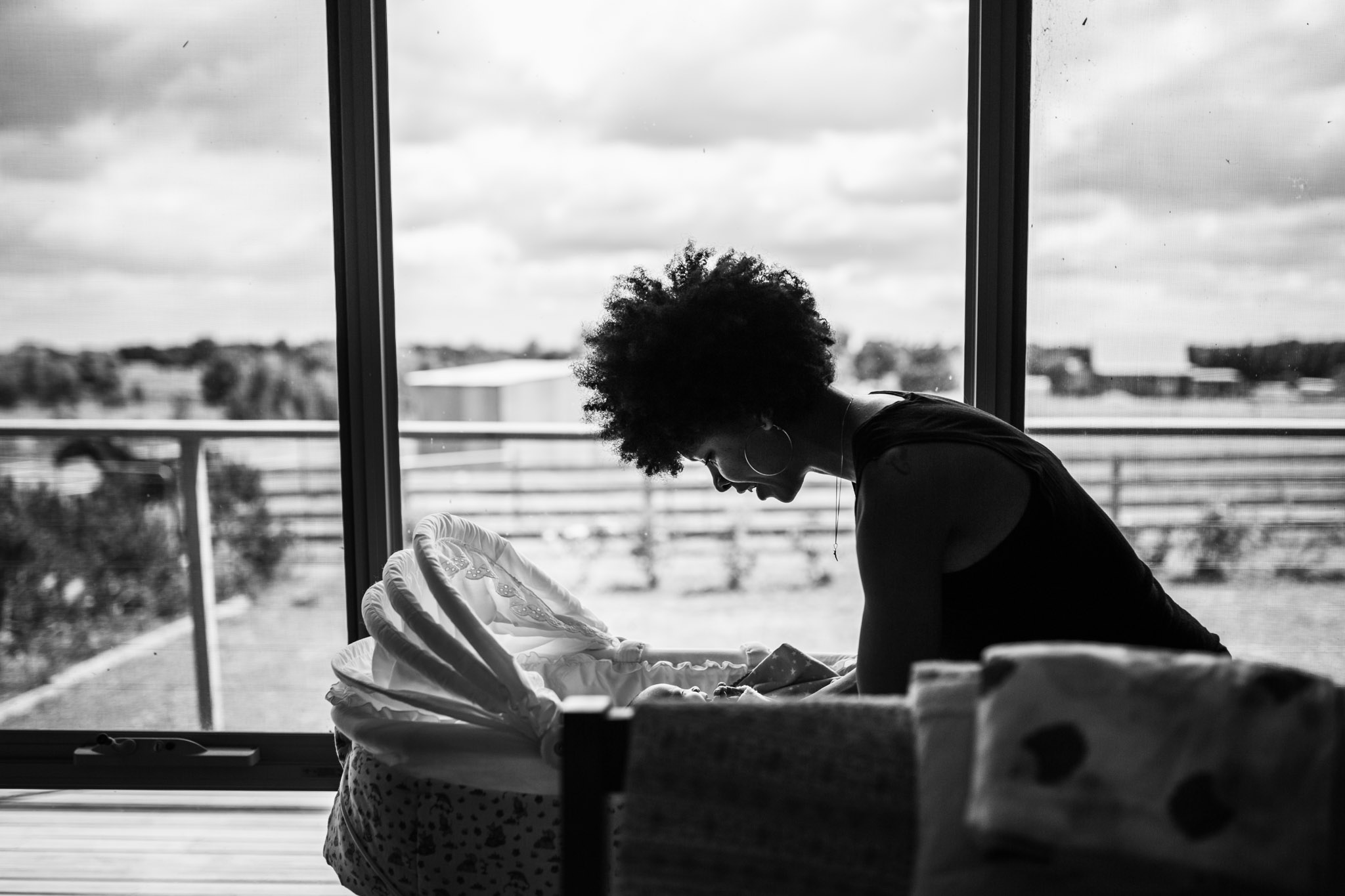 mother-lifting-baby-from-bassinet-silhouette-BW (1 of 1).jpg