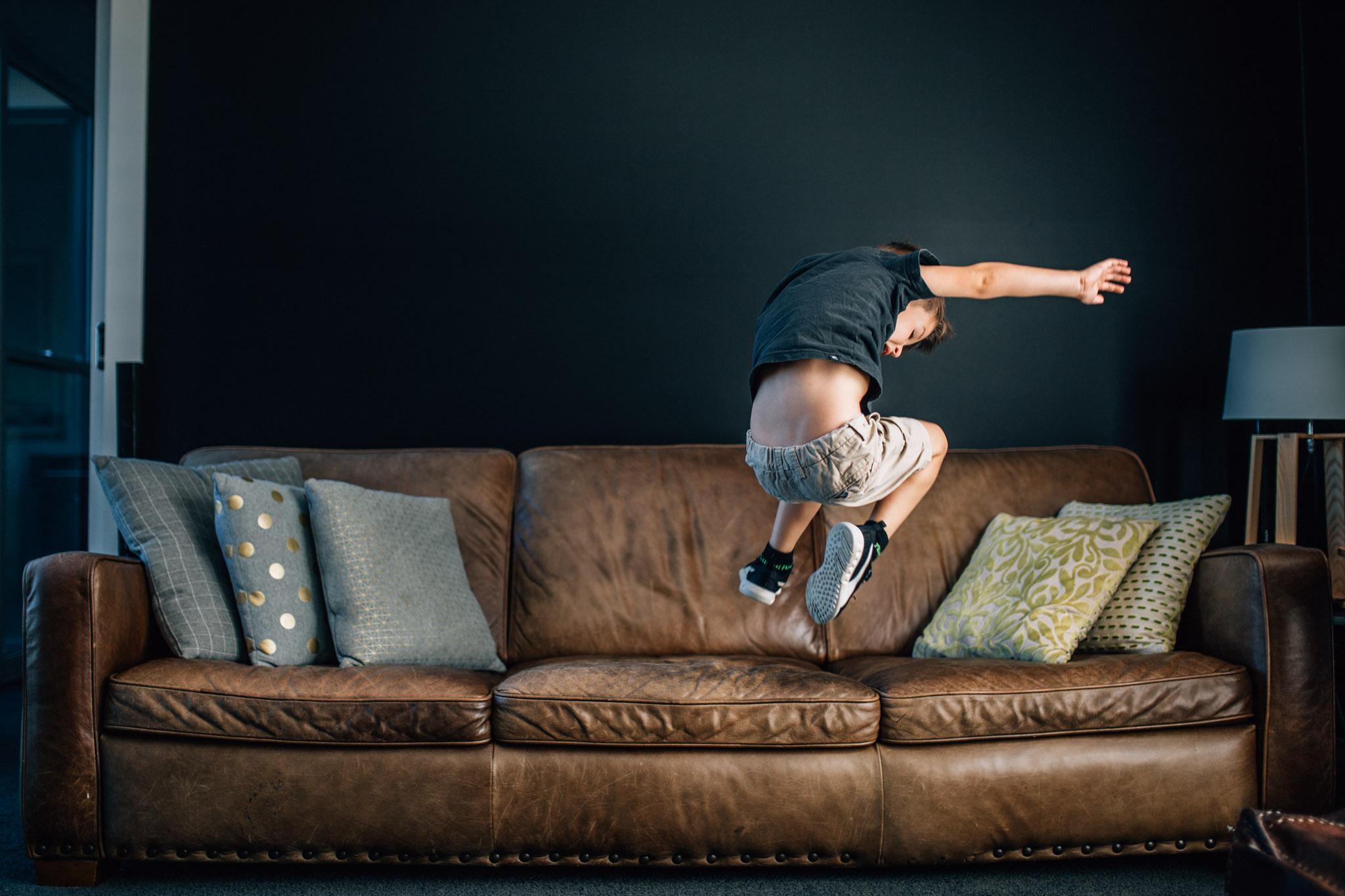 little-boy-jumping off-sofa (1 of 1).jpg