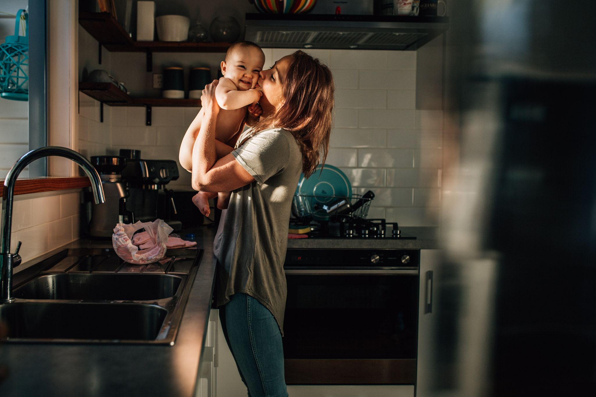 mother-kissing-baby-daughter-before-placing-her-in-sink-bath (1 of 1).jpg