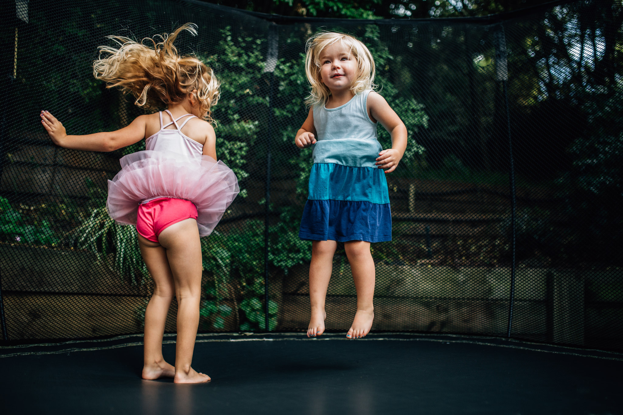 little-girls-jumping-together-on-trampoline (1 of 1).jpg