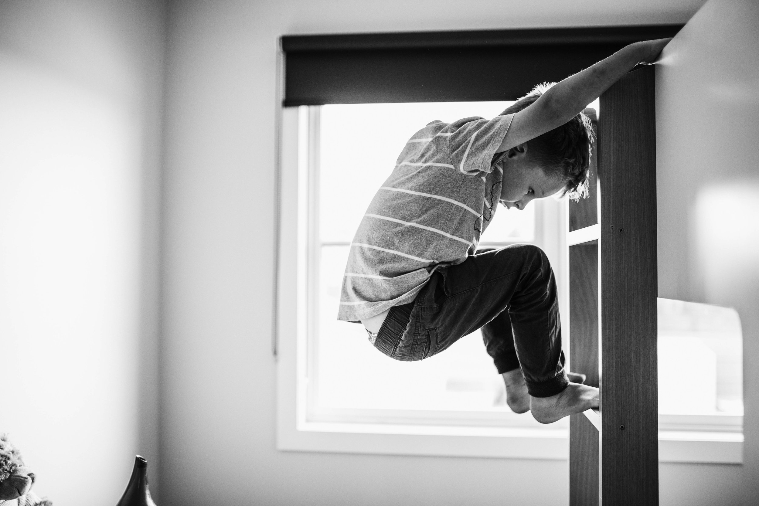 little-boy-jumping-off-the-end-of-bunk-bed.jpg