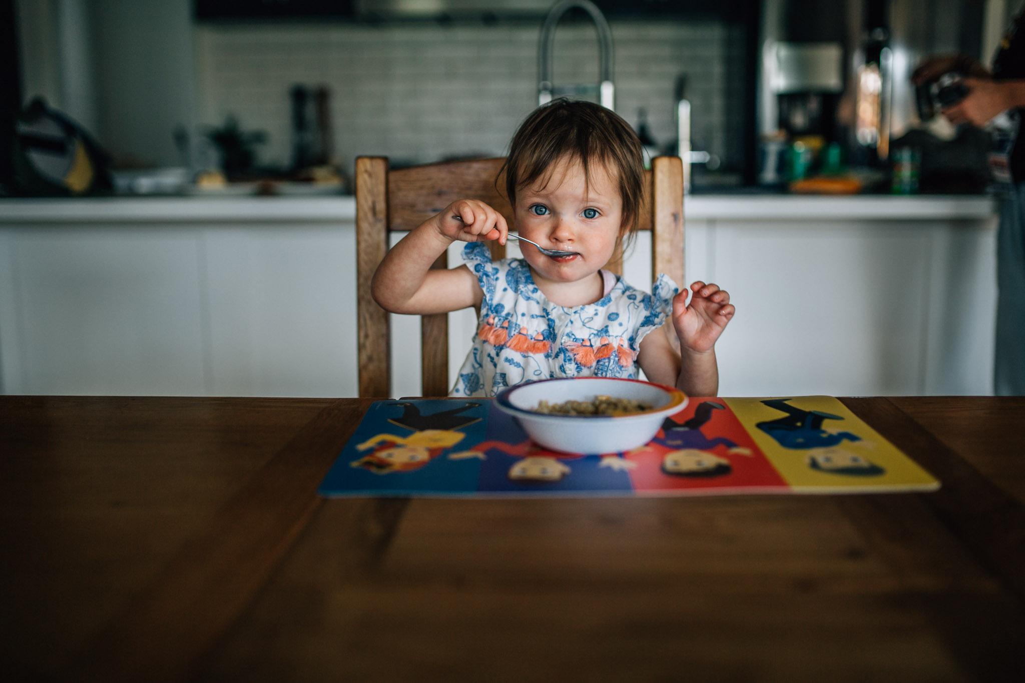 little-girl-eating-her-dinner-at-dining-table (1 of 1).jpg